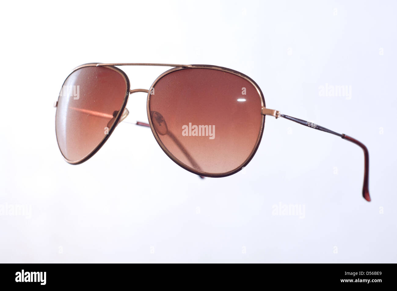 dusty lenses of brown glasses - Stock Image