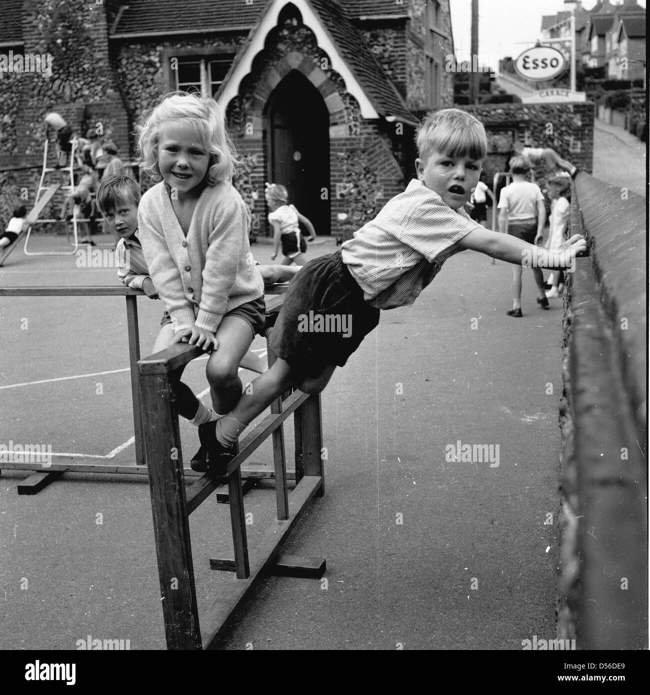 Historical 1950s Young Children Play Outside In The