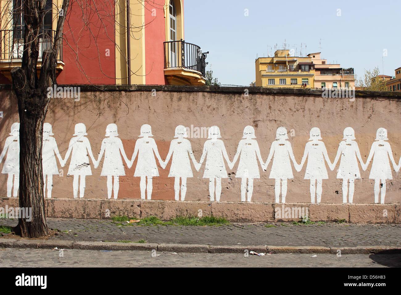 Paper doll graffiti in a public street - Rome - Stock Image