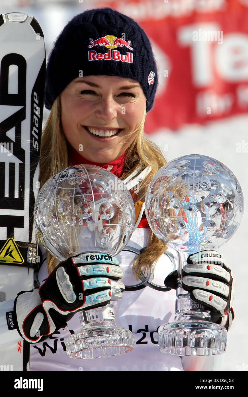 Lindsay Vonn from the USA poses with the trophies for the first-placed in the overall downhill and super G world - Stock Image