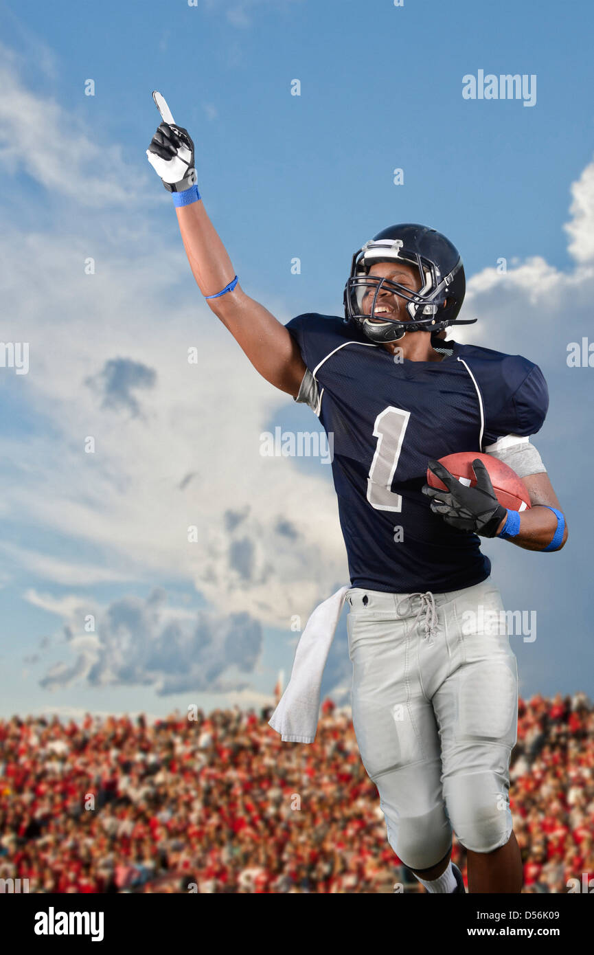 African American football player cheering in game Stock Photo