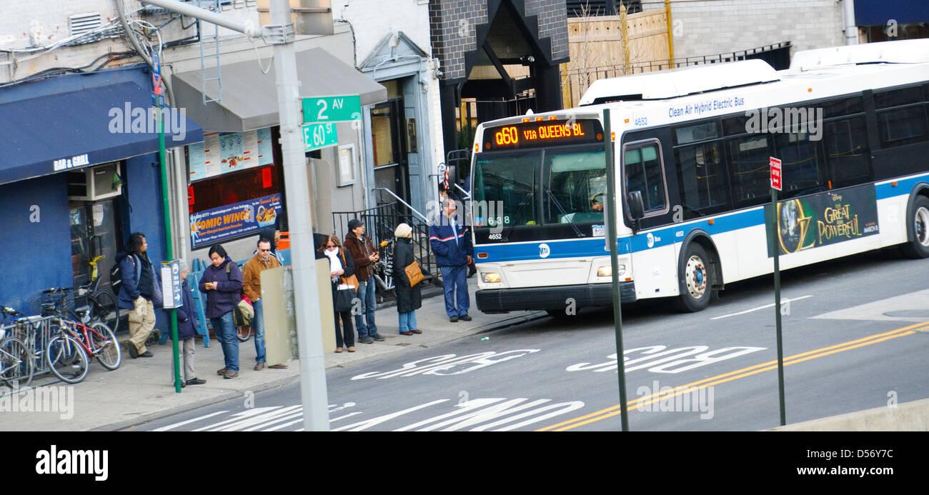 Commuters Waiting At Bus Stop Mta Q60 Public Transportation Bus Via