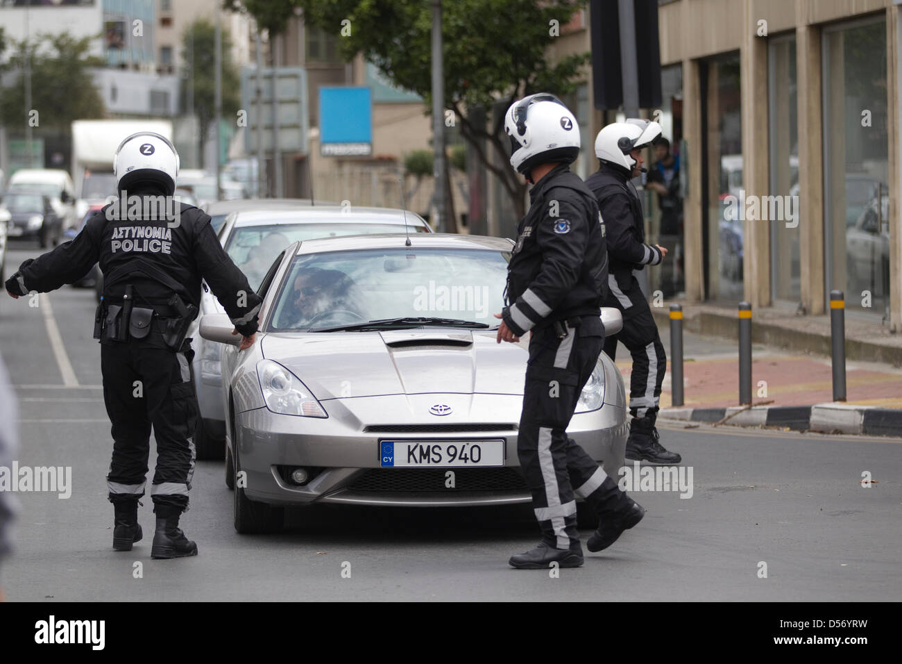 Nicosia, Cyprus. 26th March 2013.  Picture shows Police directing traffic to avoid students marching through the - Stock Image