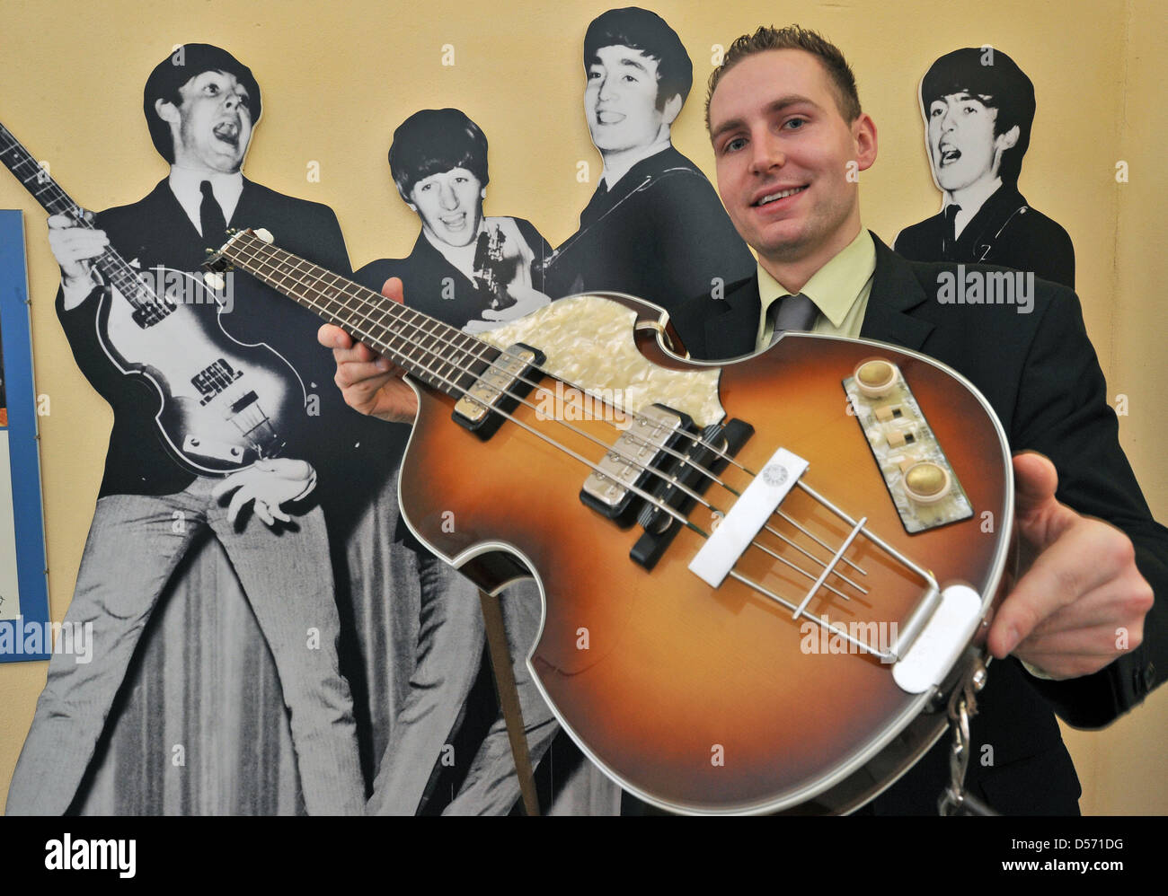 Martin Schmidt Director Of Beatles Museum Halle Saale Presents A Hofner Bass That Paul McCartney Used To Play In Germany 16 March 2010