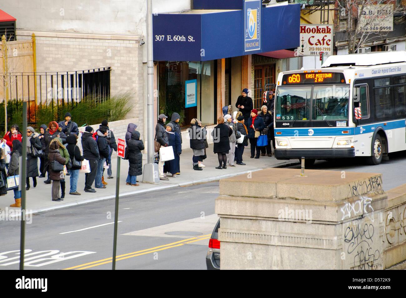Commuters Waiting At Bus Stop Mta Q60 Public Transportation Bus