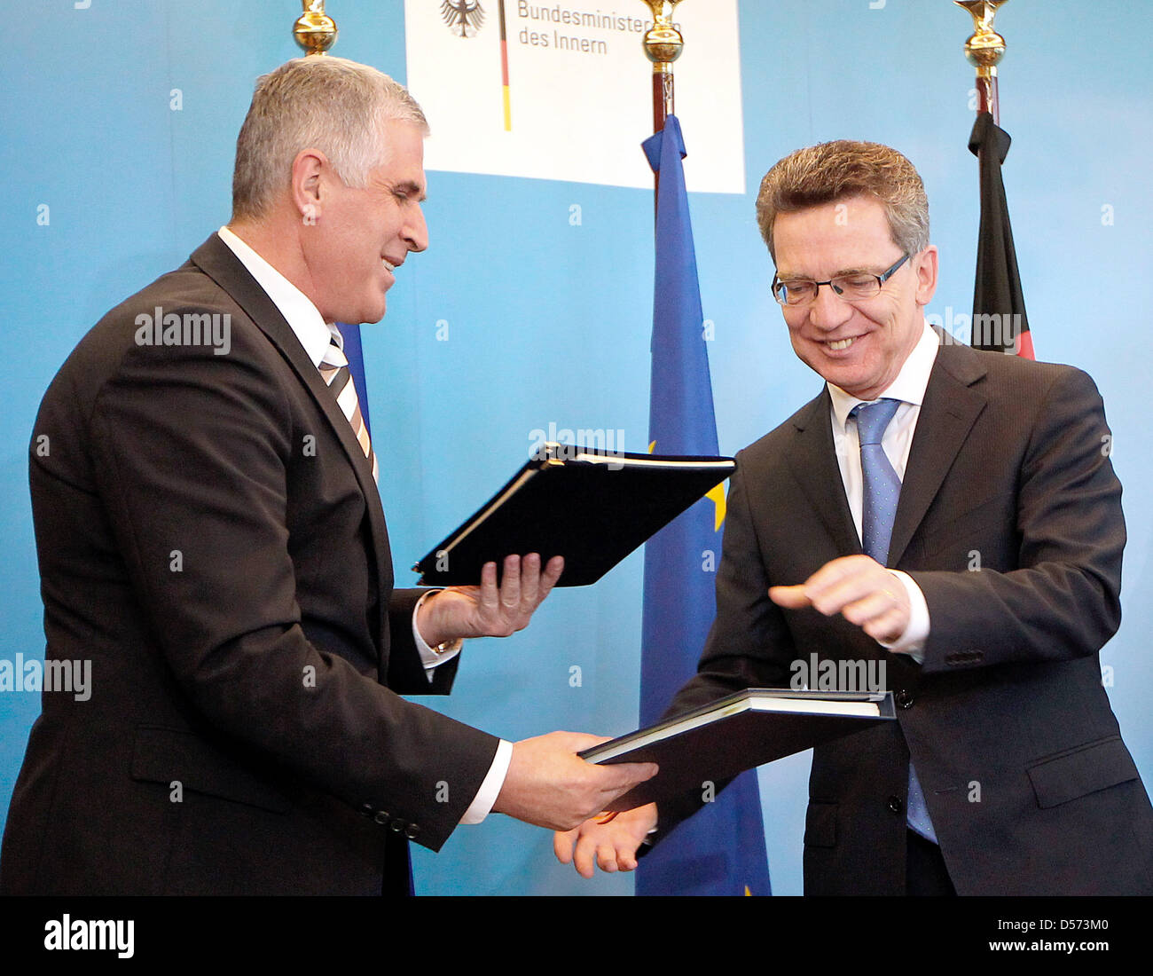 Kosovo's new Interiour Minister Bayram Rexhepi (L) and his German counterpart Thomas de Maiziere sign a readmission - Stock Image