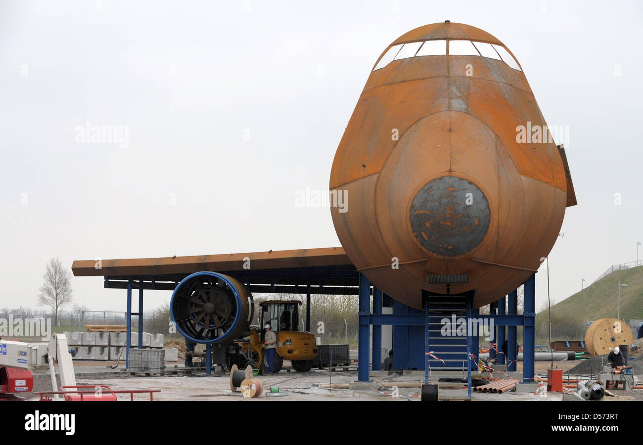A rusty replica of a Boeing 747 serves as a fire training ground in the forerunning to Interschutz' trade show in Stock Photo