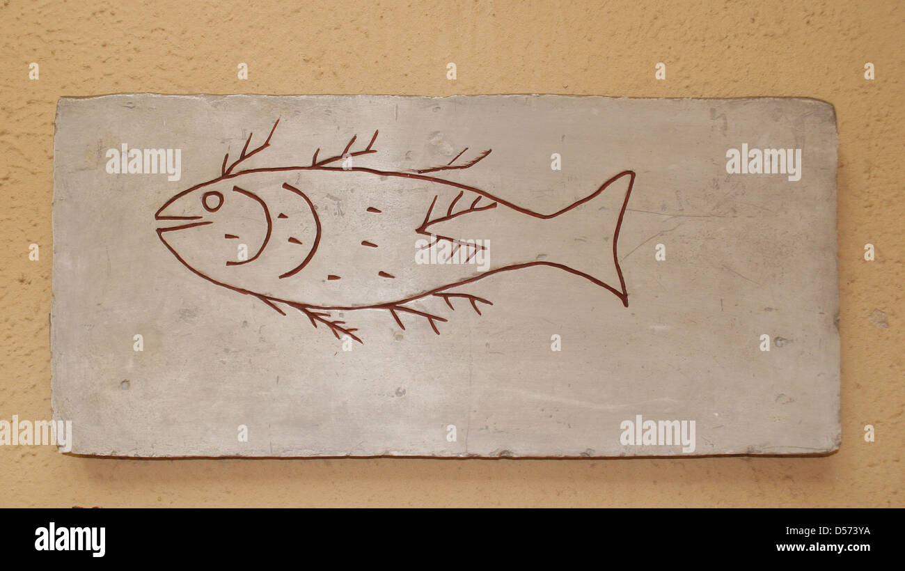 Roman tombstone with Christian iconography depicting a fish. After 4th AD. Plaster copy. Museum of Roman Civilization. - Stock Image