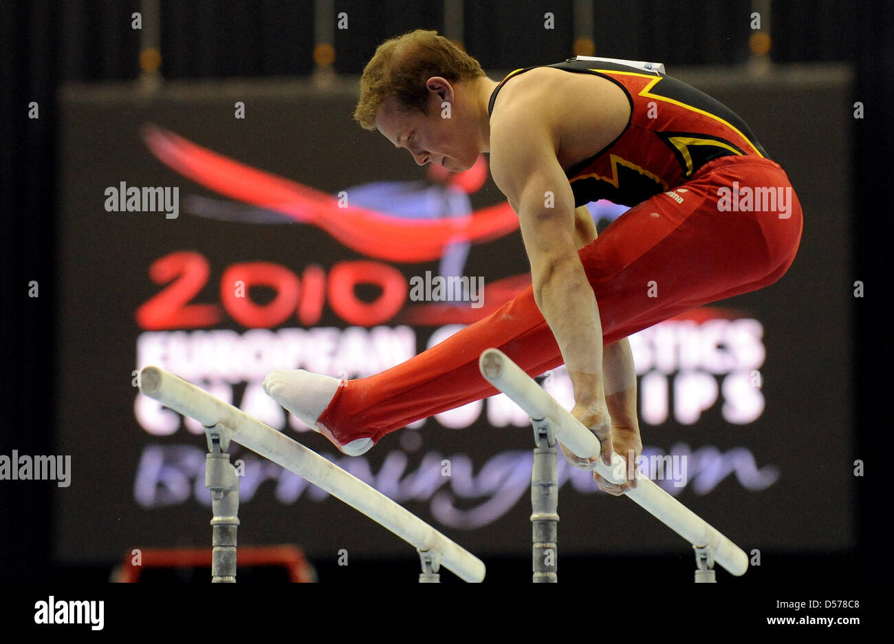 German gymnasts Fabian Hambuechen performs at the parallel bars at the European Championships Artistic Gymnastics - Stock Image