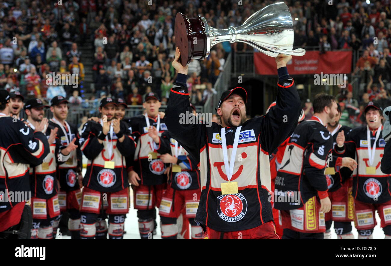 Hanover's Thomas Dolak lifts the trophy for wining the German Championship in Hanover, Germany, 25 April 2010. - Stock Image