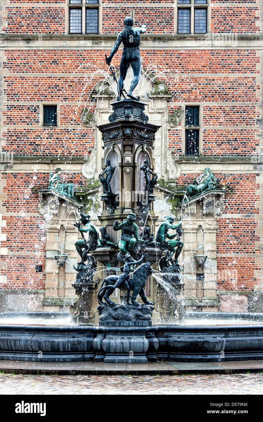 Statues on the fountain at the entrance to Frederiksborg Castle, Hillerod, Denmark - Stock Image