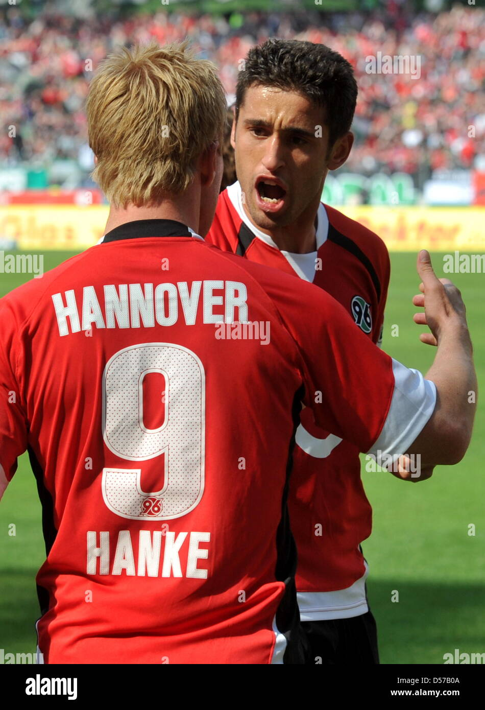 Hanover's Mike Hanke (L) and Karim Haggui cheer after Haggui's goal to the score 1-0 during German Bundesliga match Stock Photo