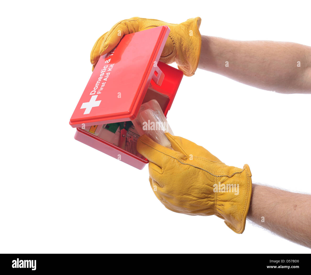 construction worker with glove taking a bandage from a first aid box - Stock Image