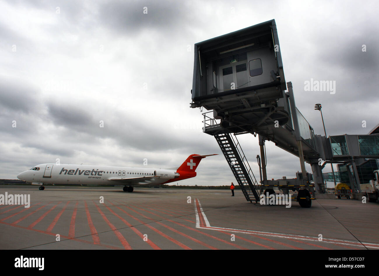 An airplane of the airline Helvetic Airways arrives for the first time at the airport Rostock-Laage in Rostock, - Stock Image