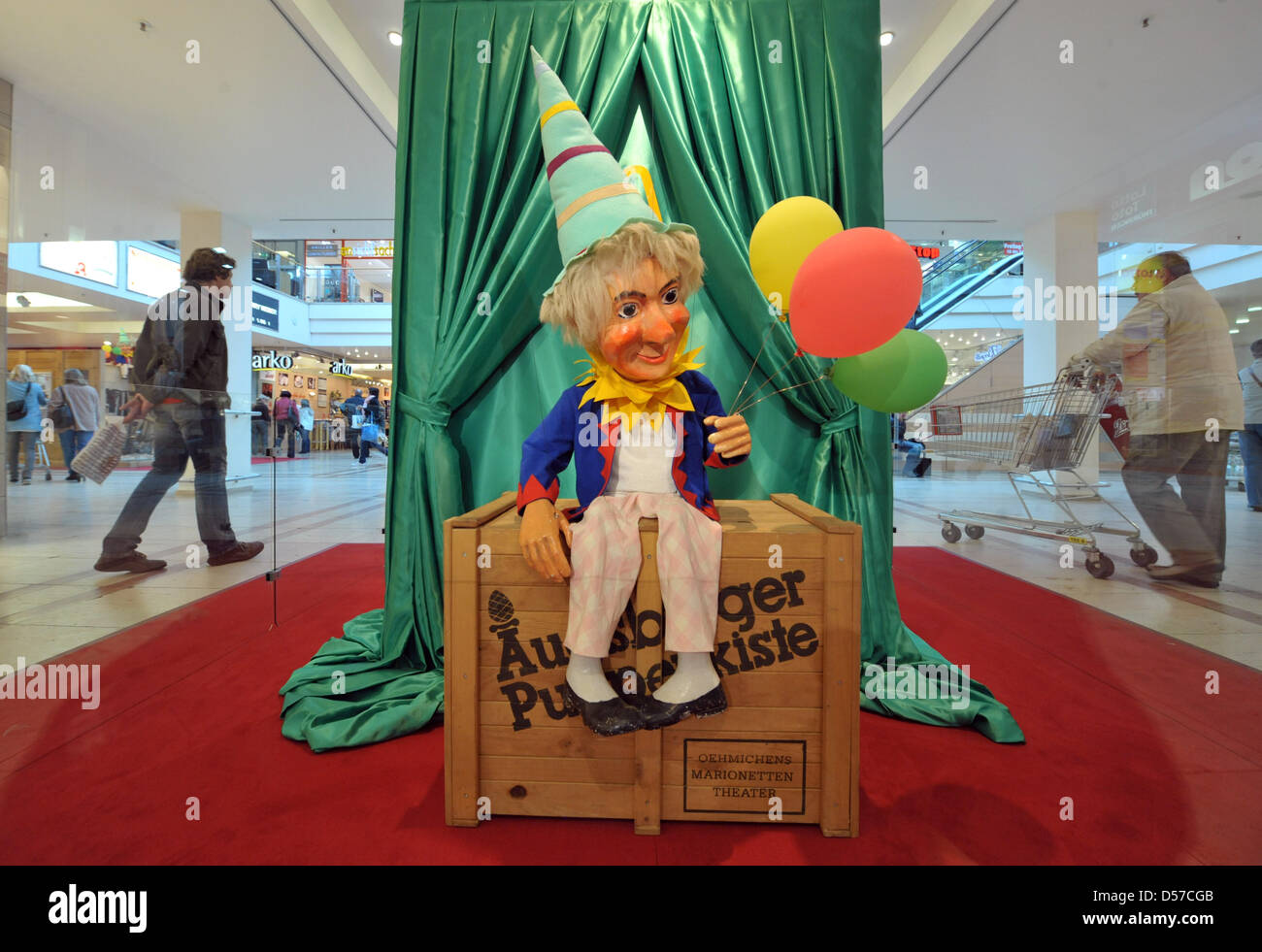 The buffoon sits on the famous Augsburger Puppenkiste of marionette theatre Augsburger Puppenkiste at Thuringia - Stock Image