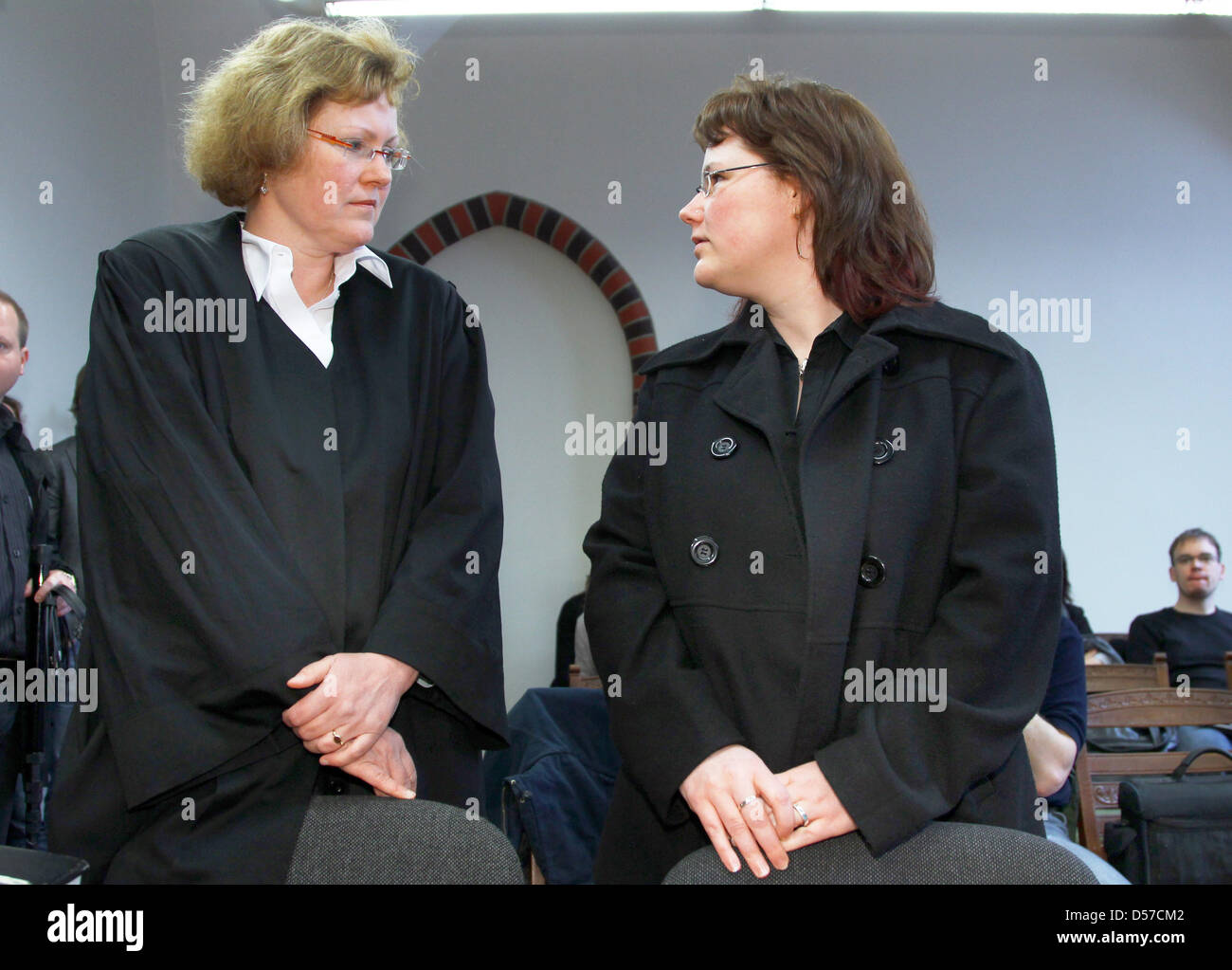 Young widow Ines S. (R) and her lawyer Silke Mettner await the decision of the higher regional court Rostock, Germany, - Stock Image