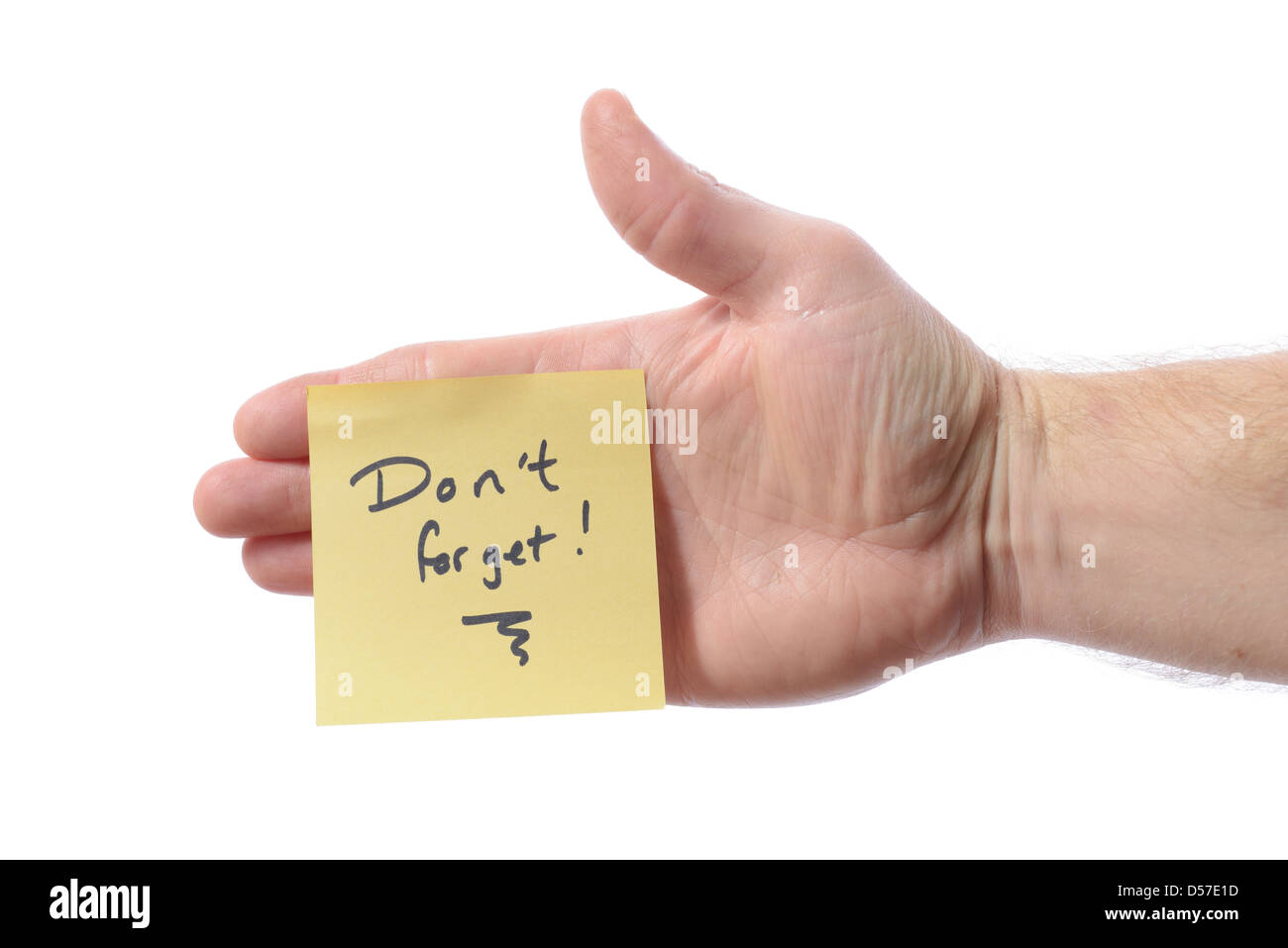post it note with don't forget as a reminder note on hand isolated on white - Stock Image