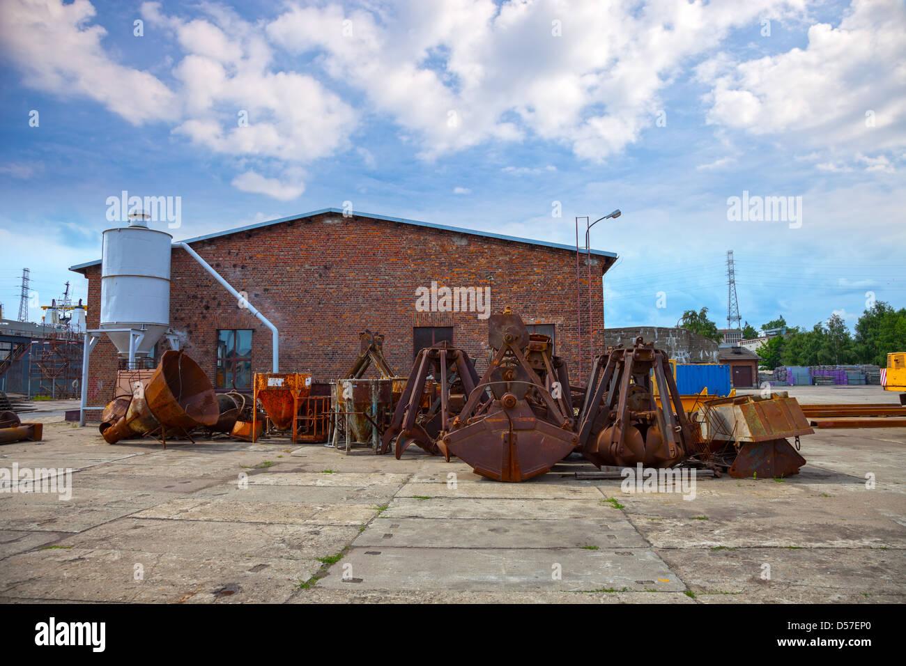 Many old rusty excavators bucket. - Stock Image