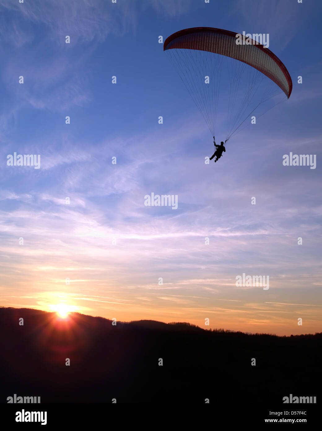 Paraglider at Sunset Stock Photo