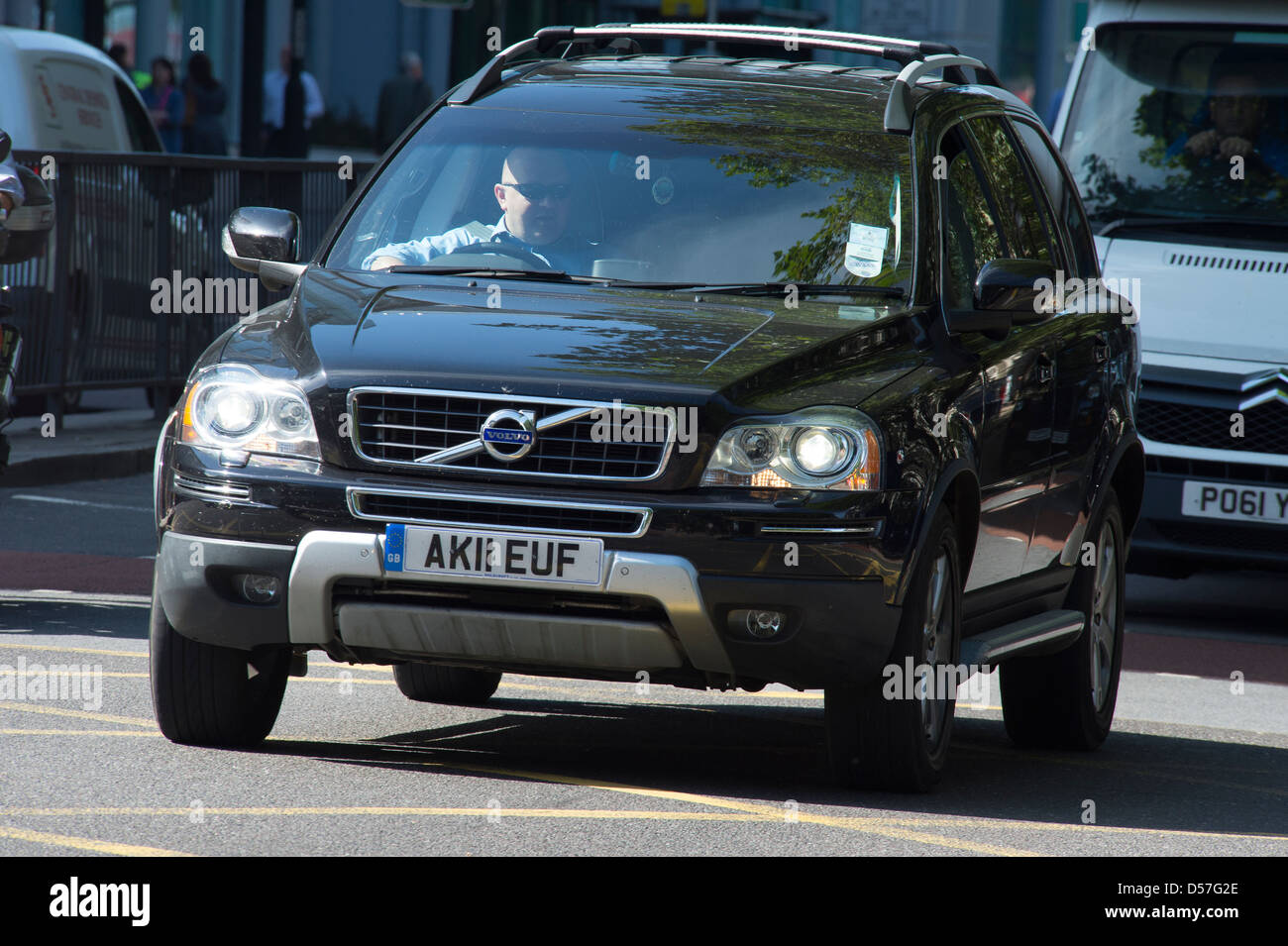 Volvo car being driven in city centre traffic, England. - Stock Image