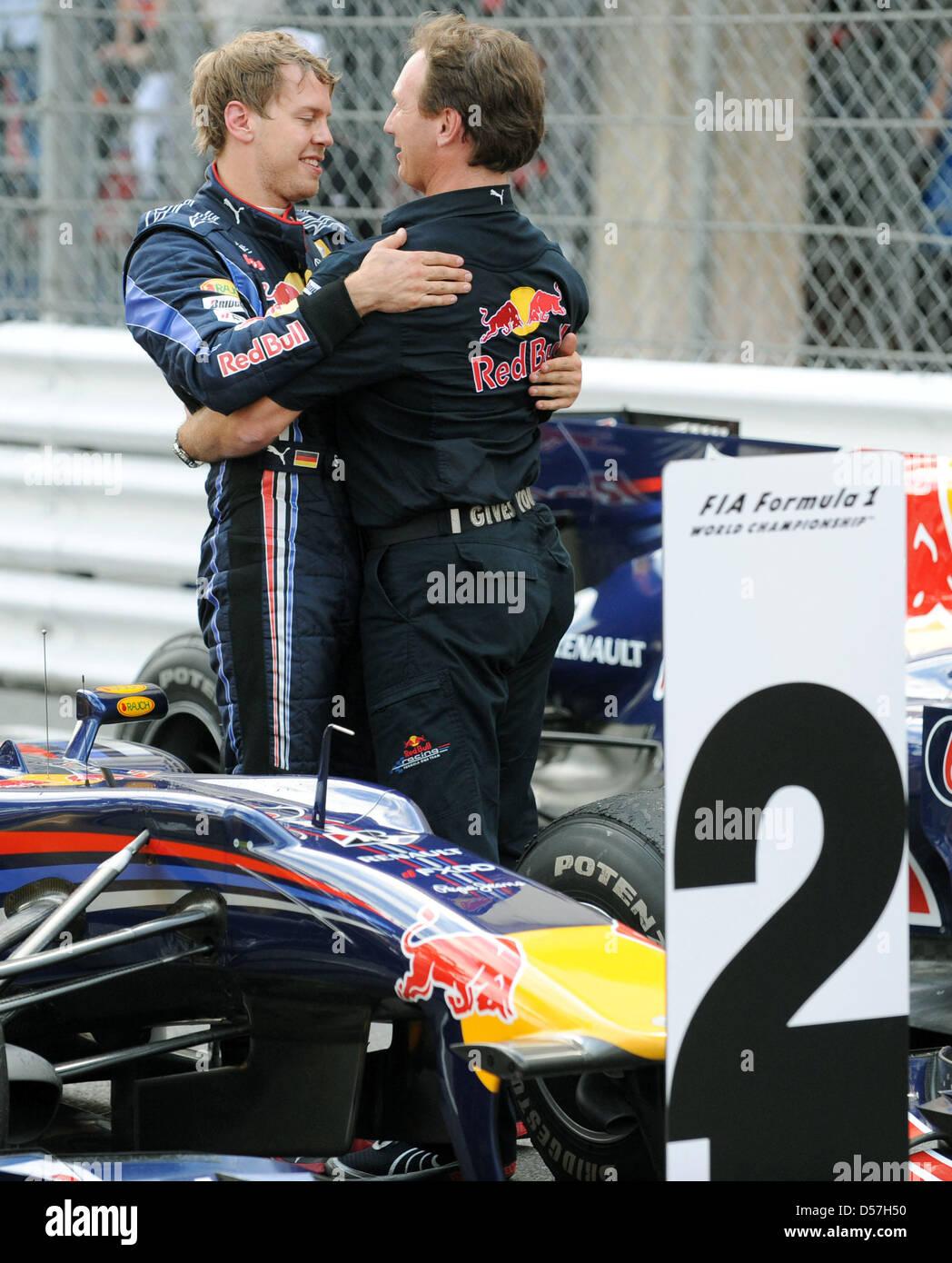 b6f47b39 German driver Sebastian Vettel of Red Bull Racing (L) and his team  principal Christian Horner (R) hug after the 2010 Formula 1 Grand Prix of  Monace held in ...