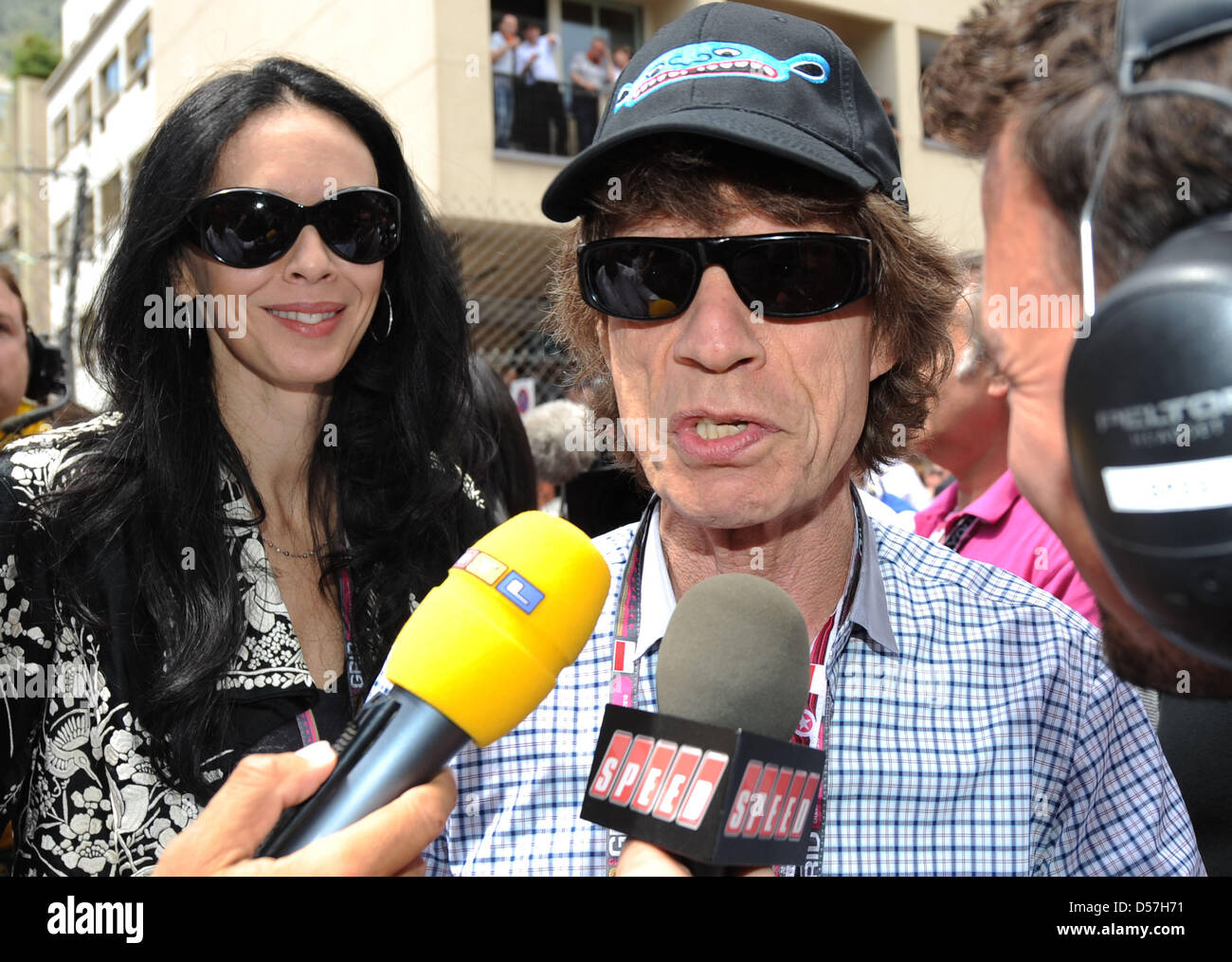 Mick Jagger Of The Rolling Stones Smiles In The Grid Of The 2010