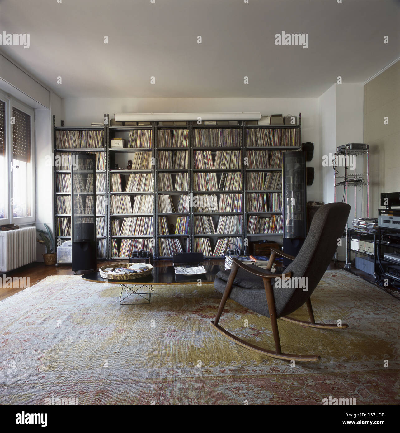 Interior Of A Living Room In An Apartment With A Rocking Chair And  Bookshelves With Plenty Of Vinyl Records And A Professional Stereo Equipment