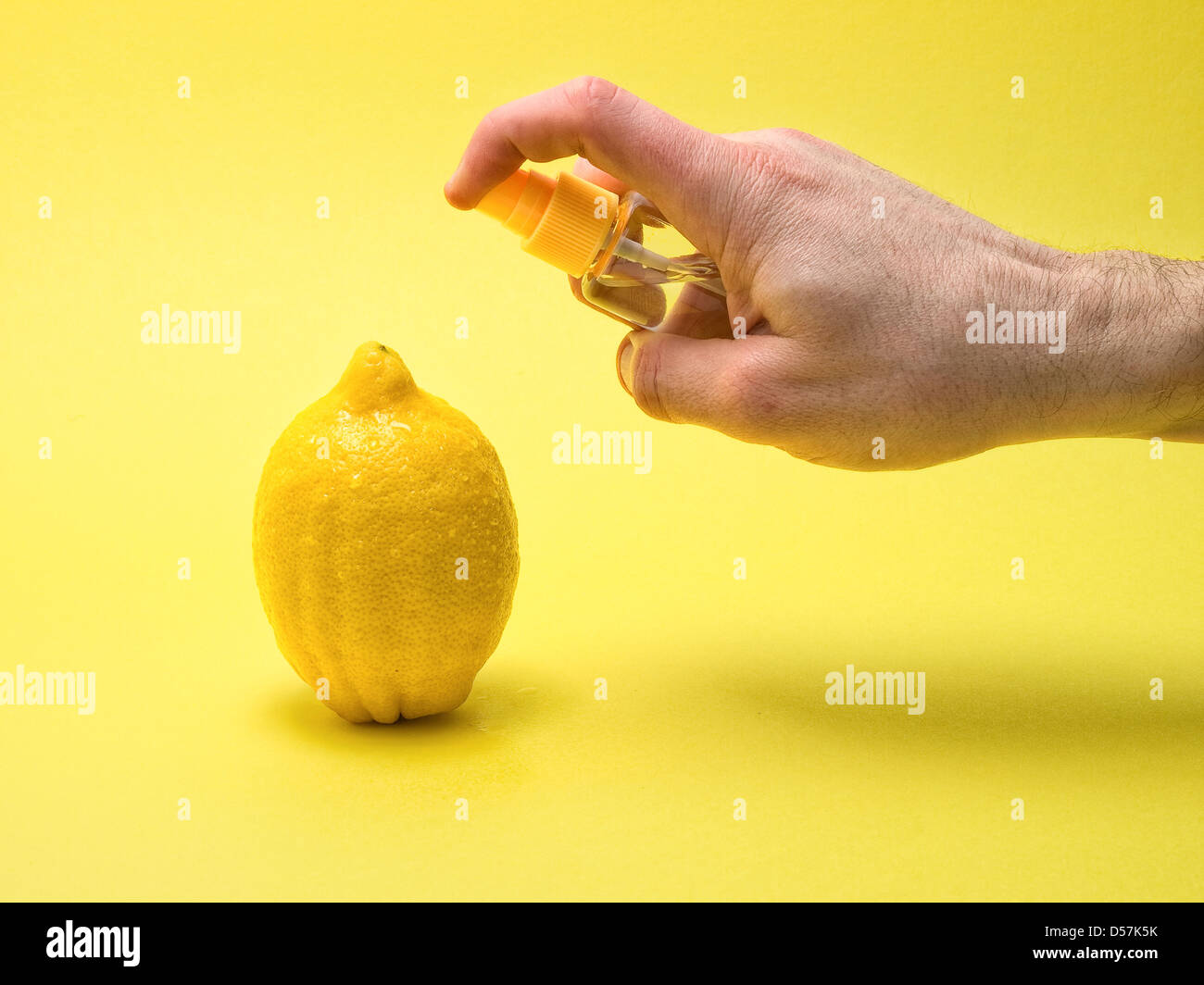 Applying glycerin to a lemon. It aims to give a fresh and healthy fruit; advertising photography. - Stock Image