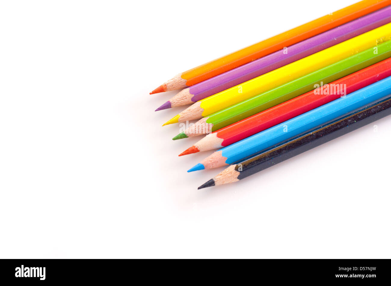 Colorful rainbow of pencil crayons or back to school image - Stock Image