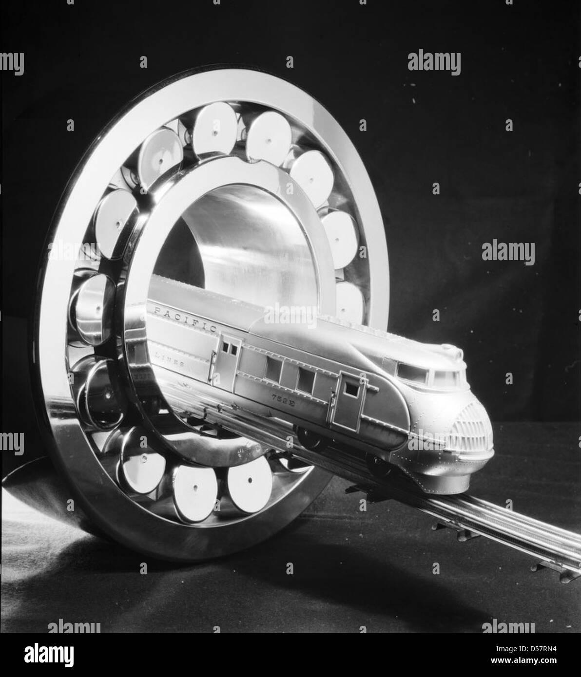 S. K. F. Bearing, Train coming thru bearing - Stock Image