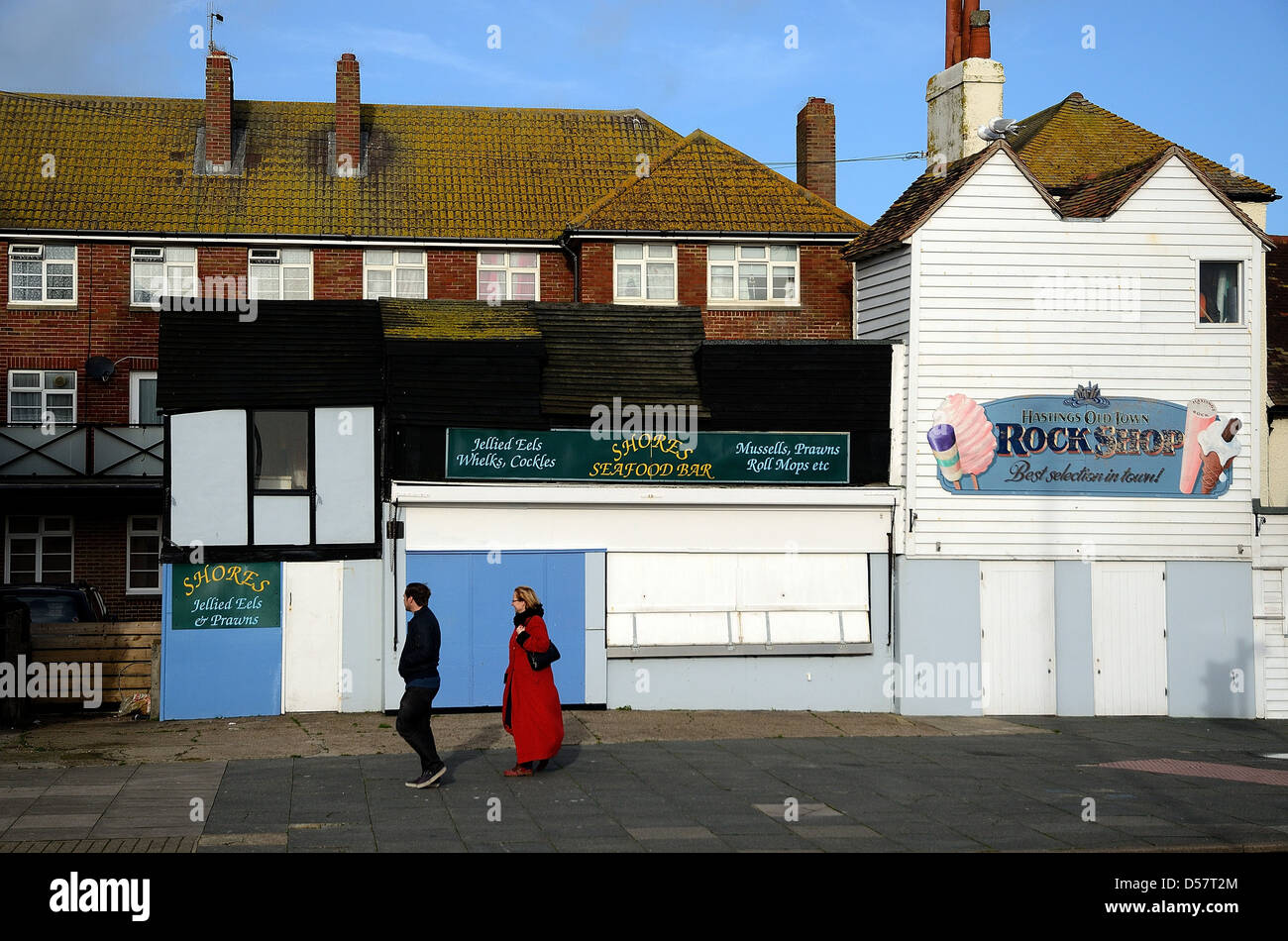 Closed seaside shop fronts in Hastings old town Sussex - Stock Image