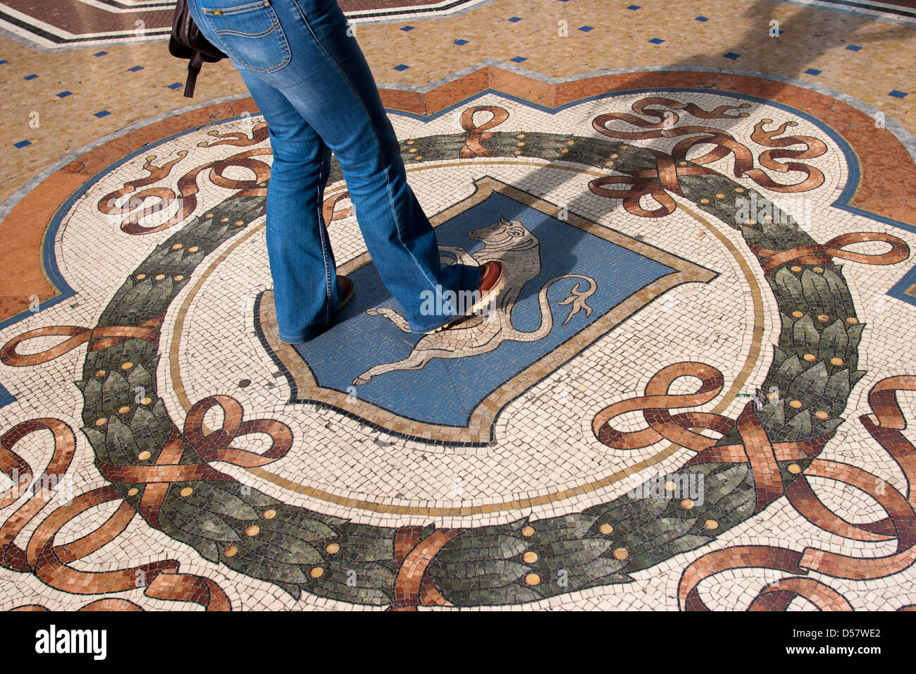 Spinning on bulls genitals for good luck Galleria Vittorio Emanuele II Arcade Milan - Stock Image