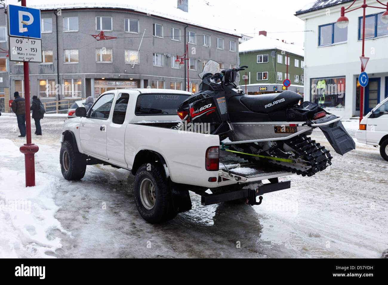 pickup truck carrying snowmobile Honningsvag finnmark norway europe - Stock Image