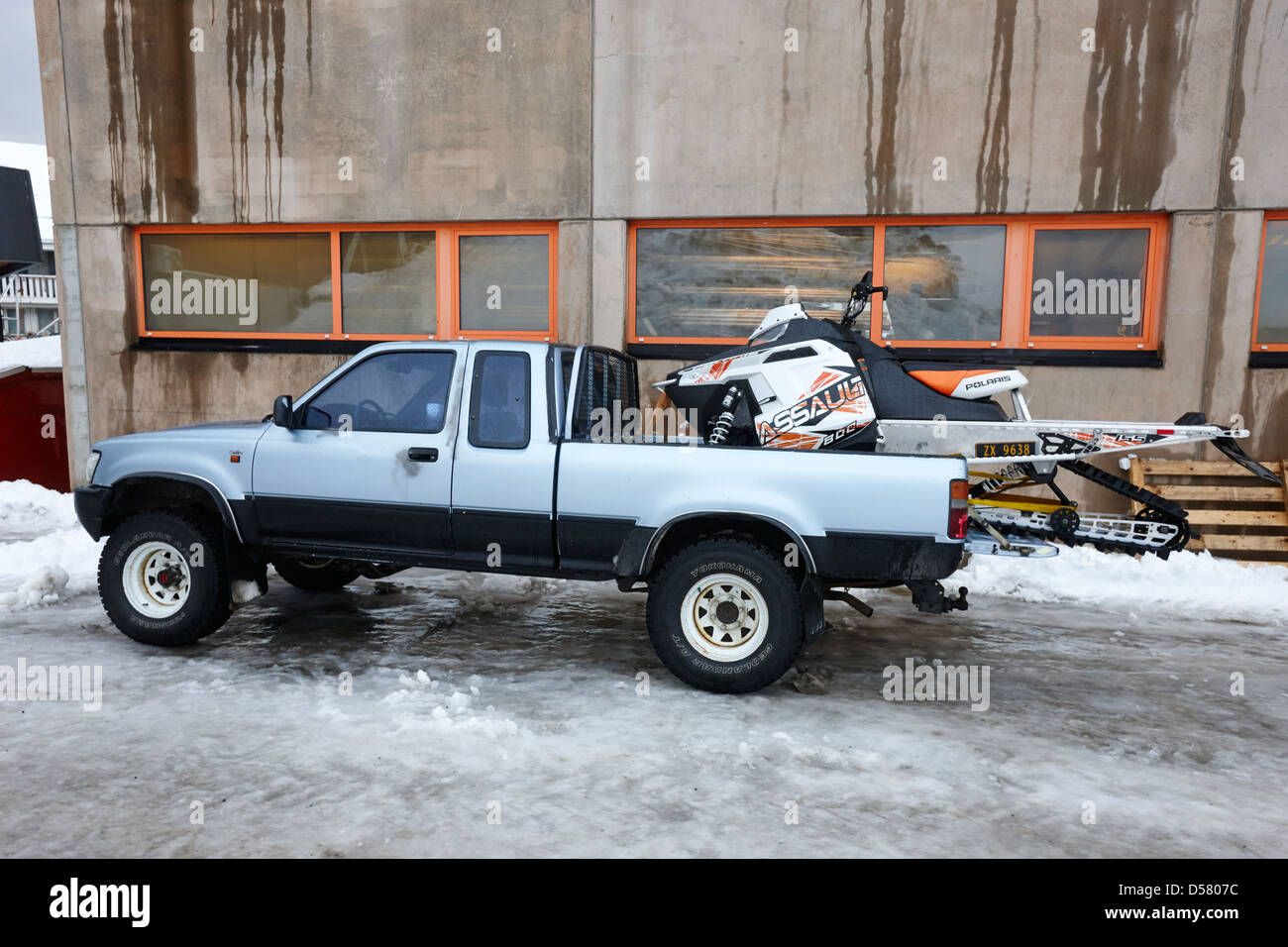 pickup truck parked carrying snowmobile Honningsvag finnmark norway europe - Stock Image