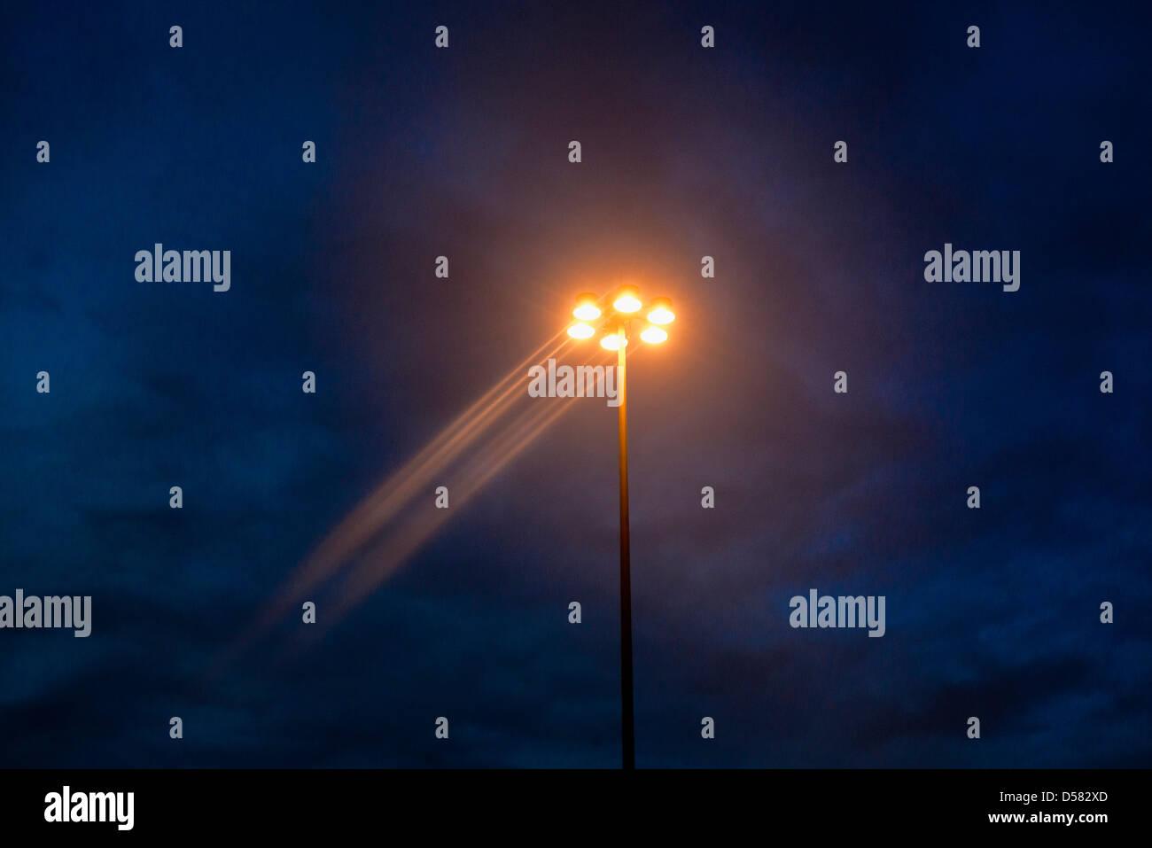 Street lamp at dusk. - Stock Image
