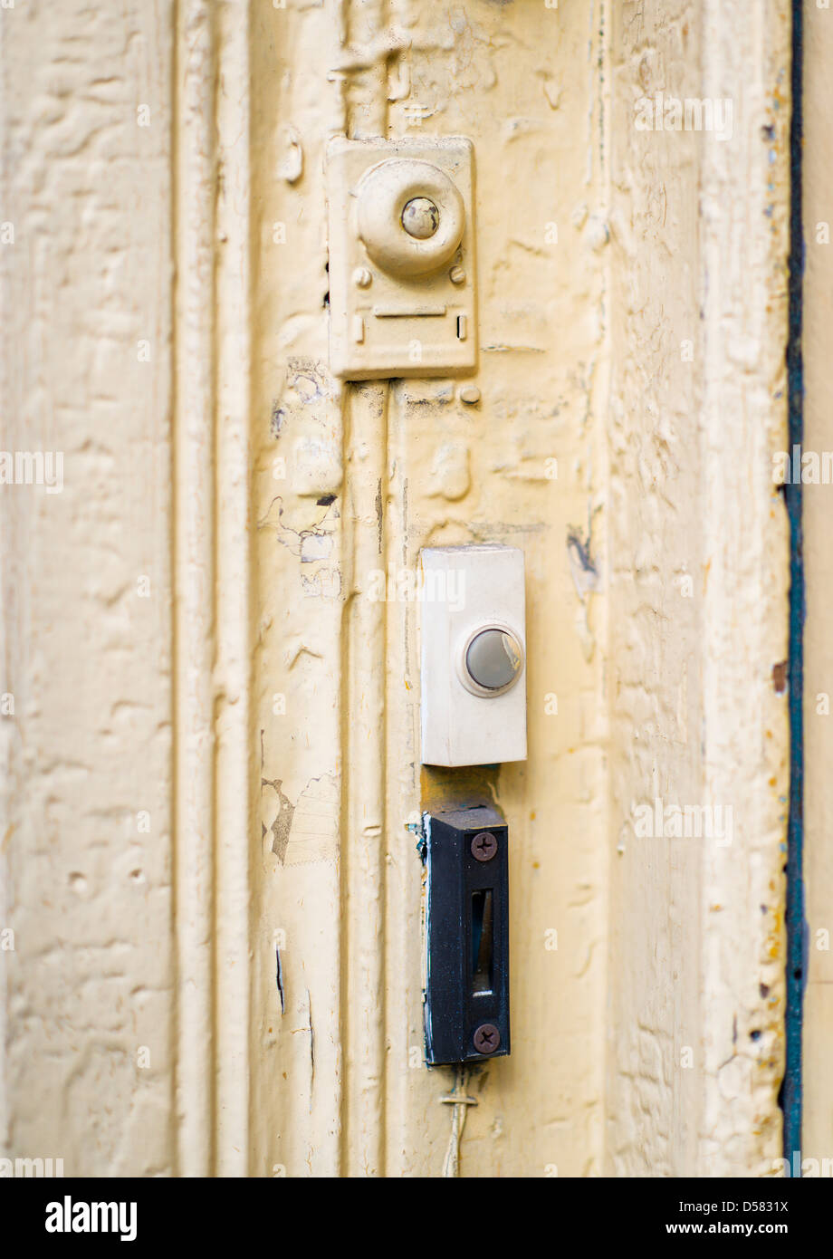 Doorbell buzzers at an apartment door. - Stock Image