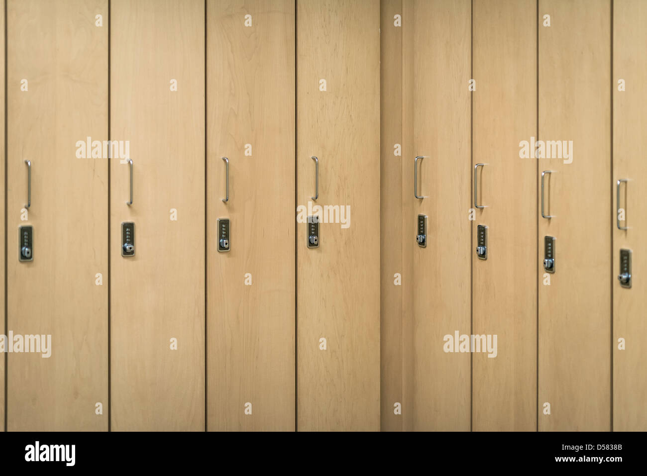 Combination lockers in a heath club locker room. - Stock Image