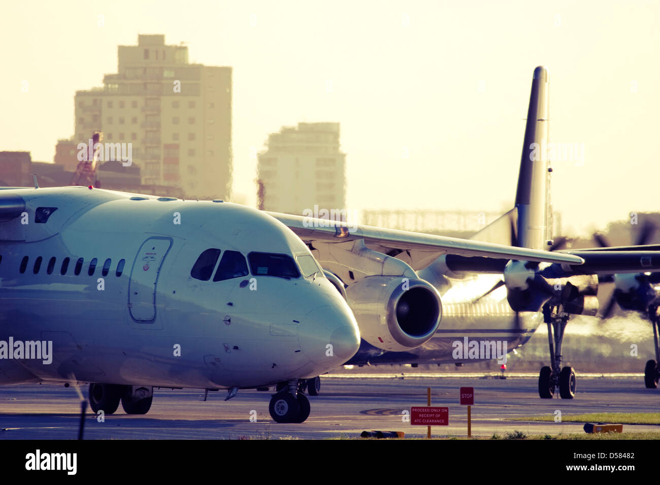 Commercial planes taxiing. - Stock Image