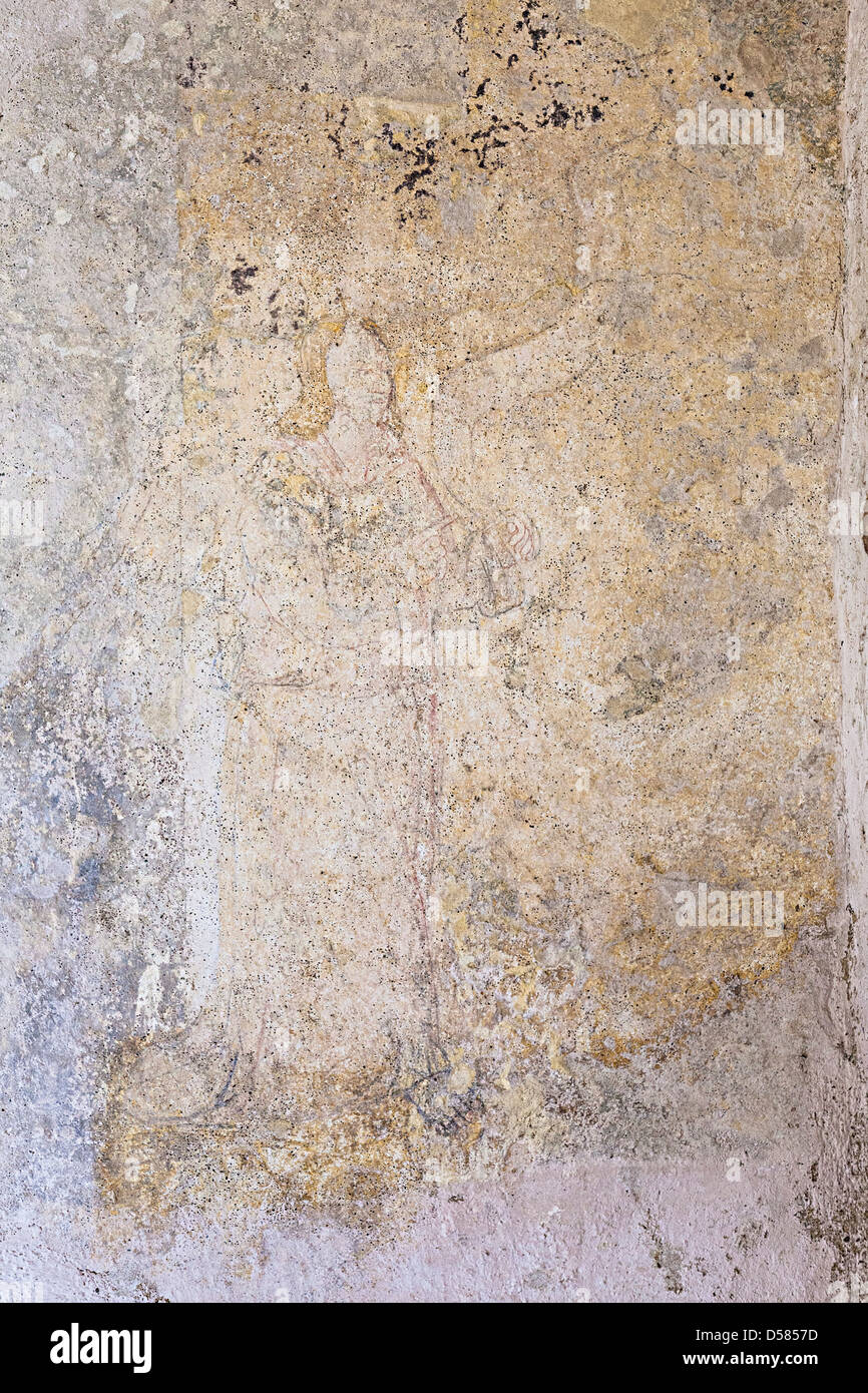 Faded wall painting of archangel in oratory of Jerusalem Chapel Hougue Bie Jersey Channel Islands UK - Stock Image