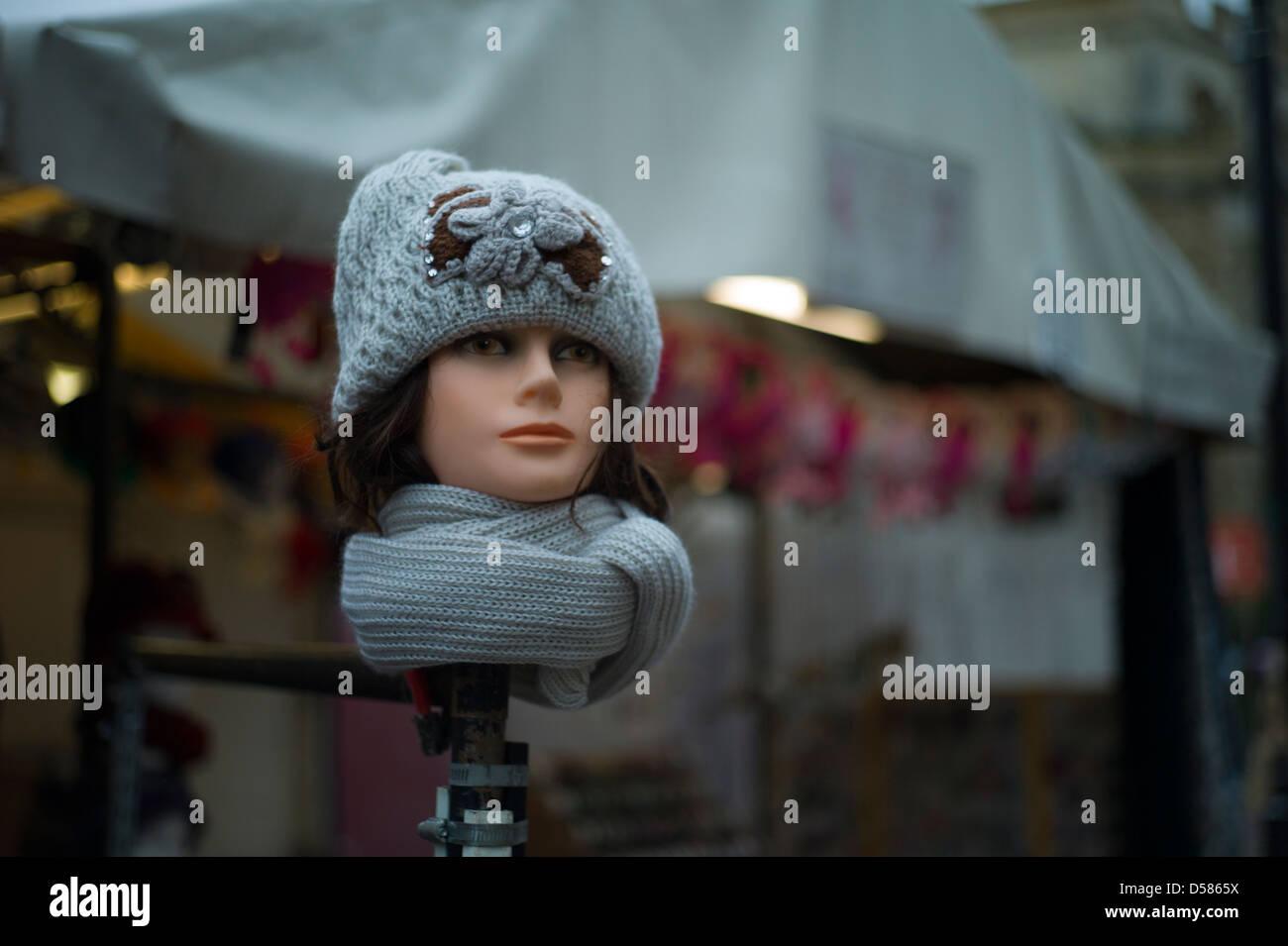 Cambridge Street Photography,Cambridge,England,January 2013. Cambridge Market, model head displays headwear. - Stock Image