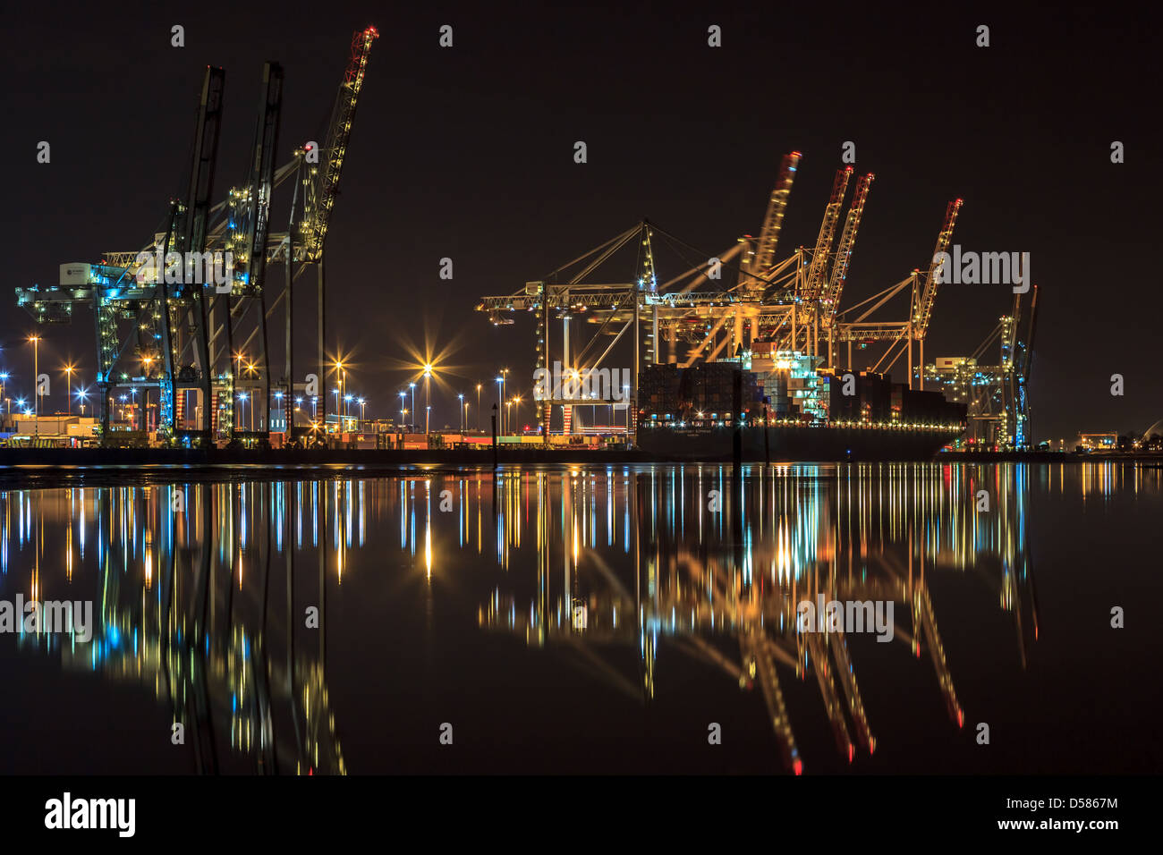 Southampton docks at night with the container ship, Frankfurt Express, being loaded. - Stock Image