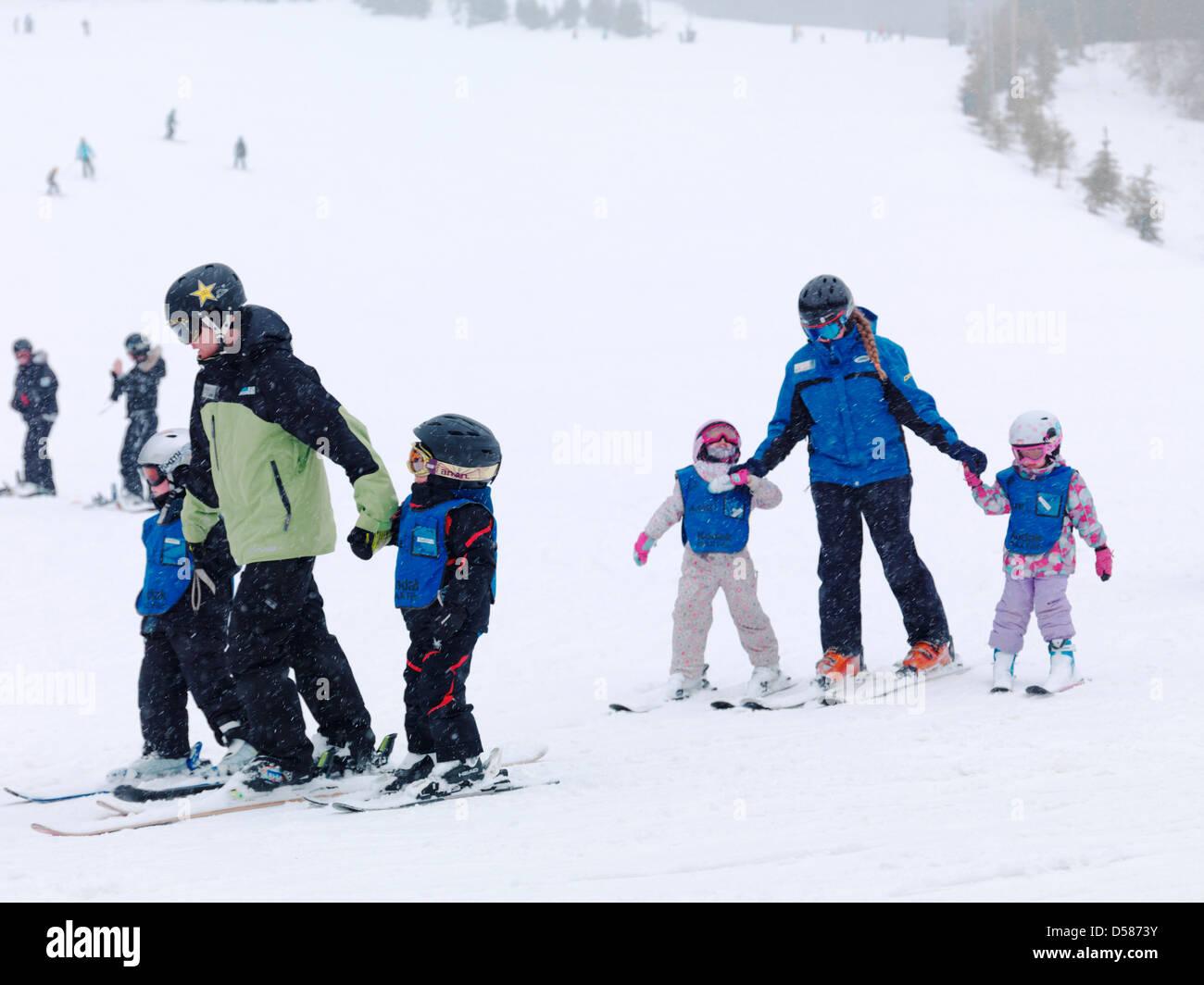 Children learning skiing at Blue Mountain, Collingwood, Ontario, Canada alpine ski resort. - Stock Image
