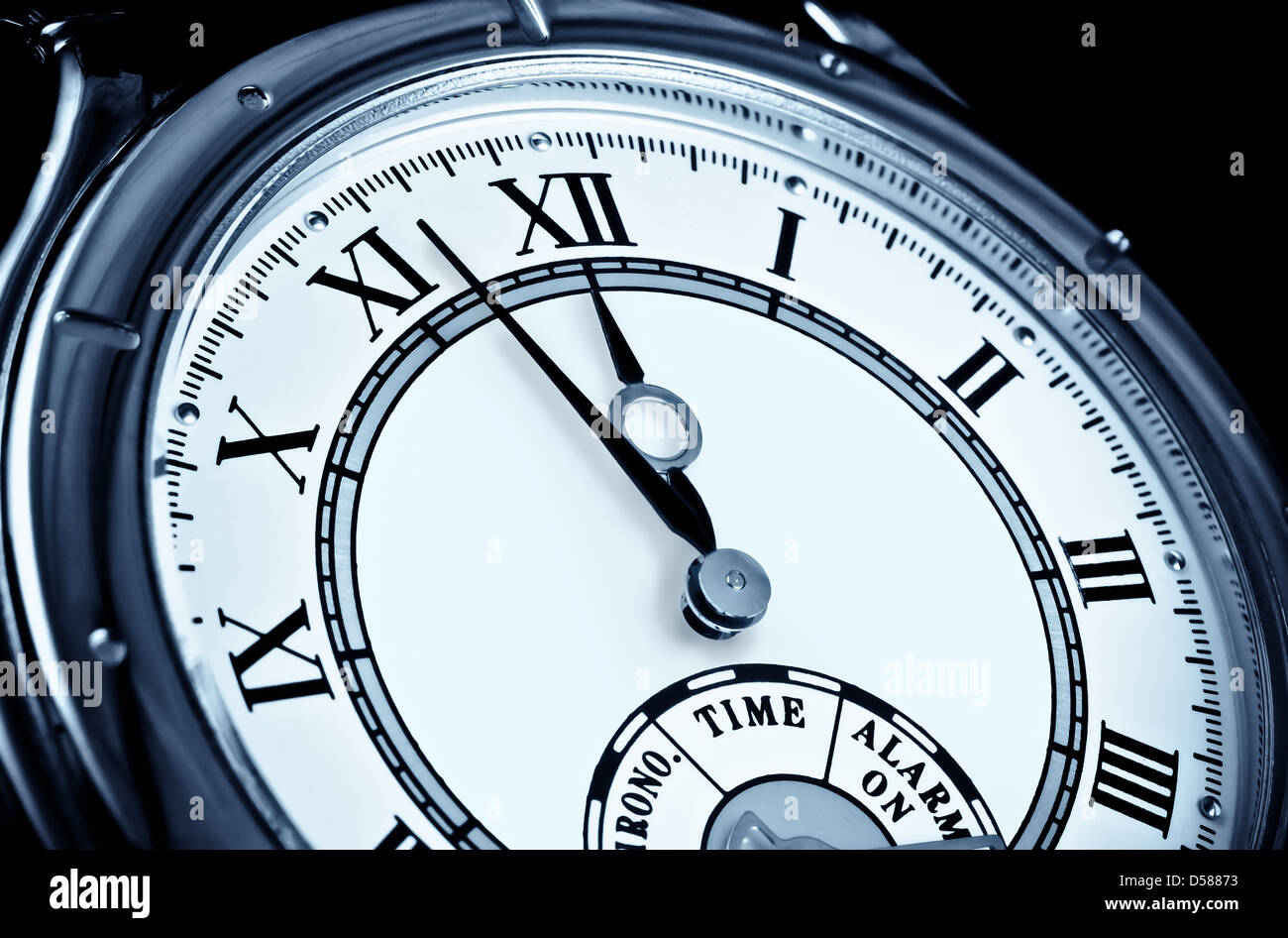 Analog wrist watch closeup at five to twelve - Stock Image
