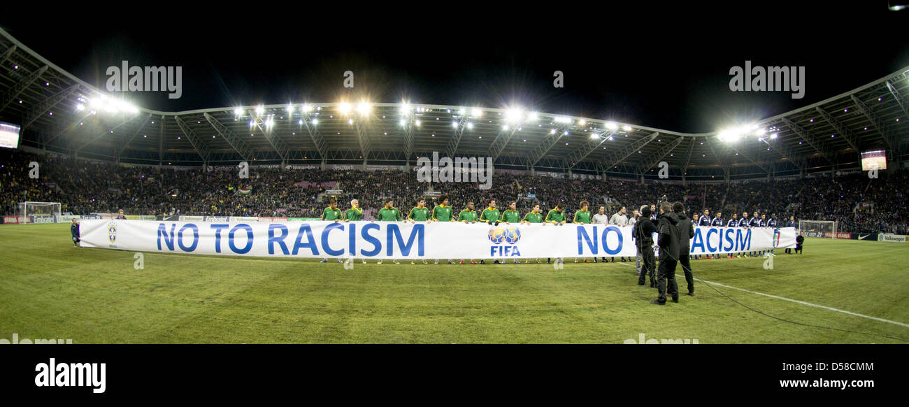 Two team groups, MARCH 21, 2013 - Football / Soccer : Players shows banner 'No Racism' before the International - Stock Image