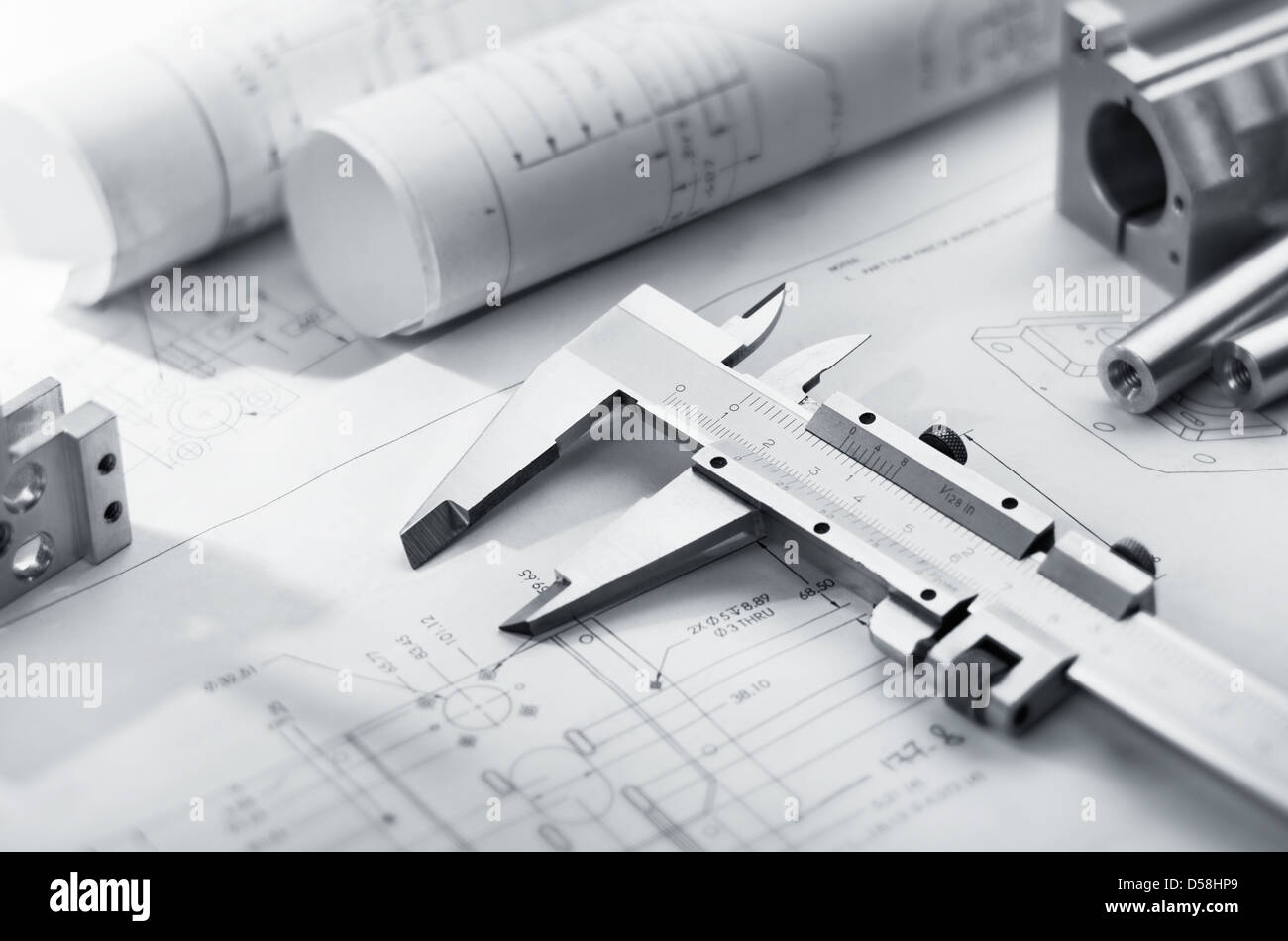 caliper and machine parts on mechanical blueprint - Stock Image