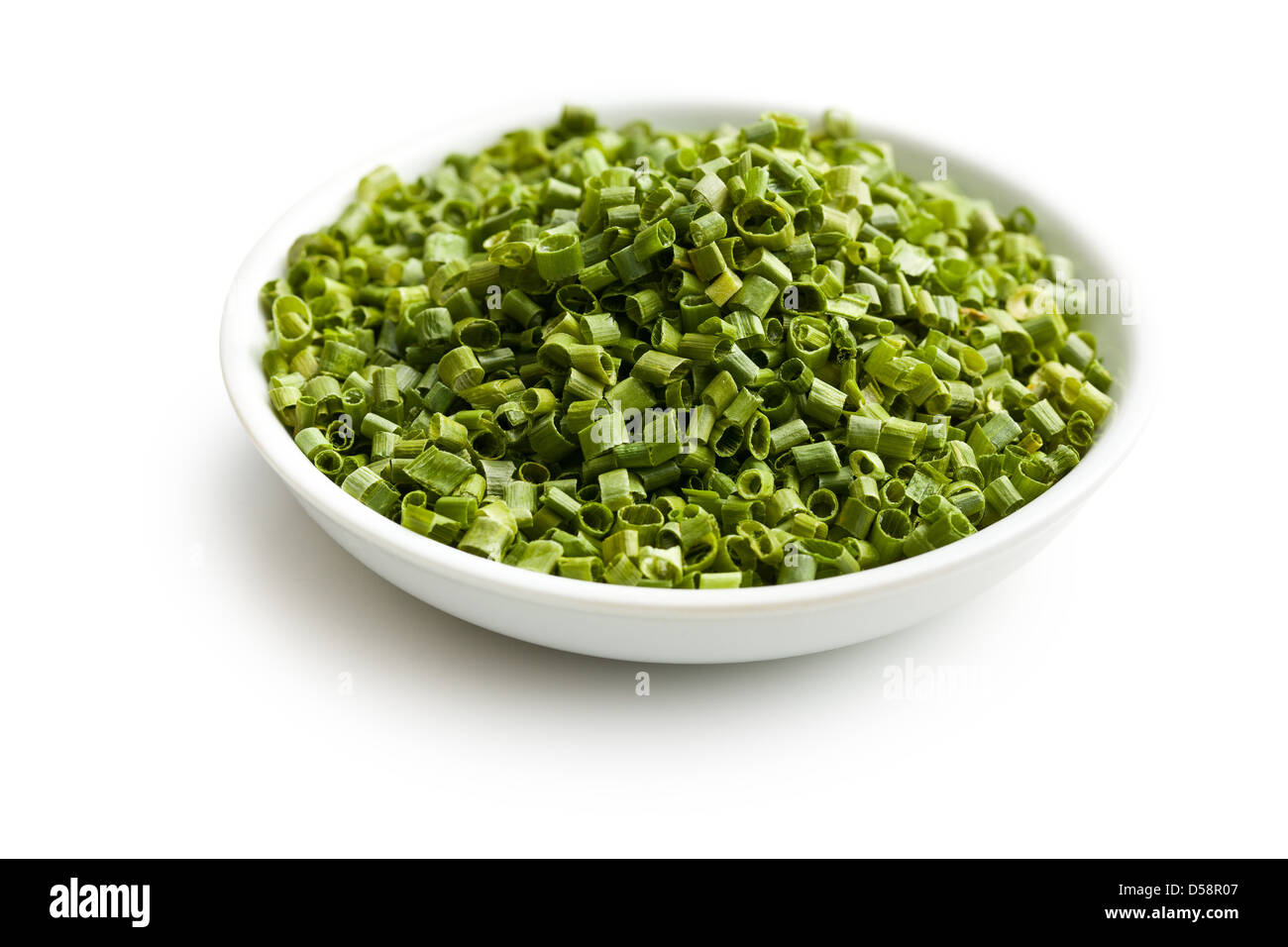 the green chives in ceramic bowl - Stock Image