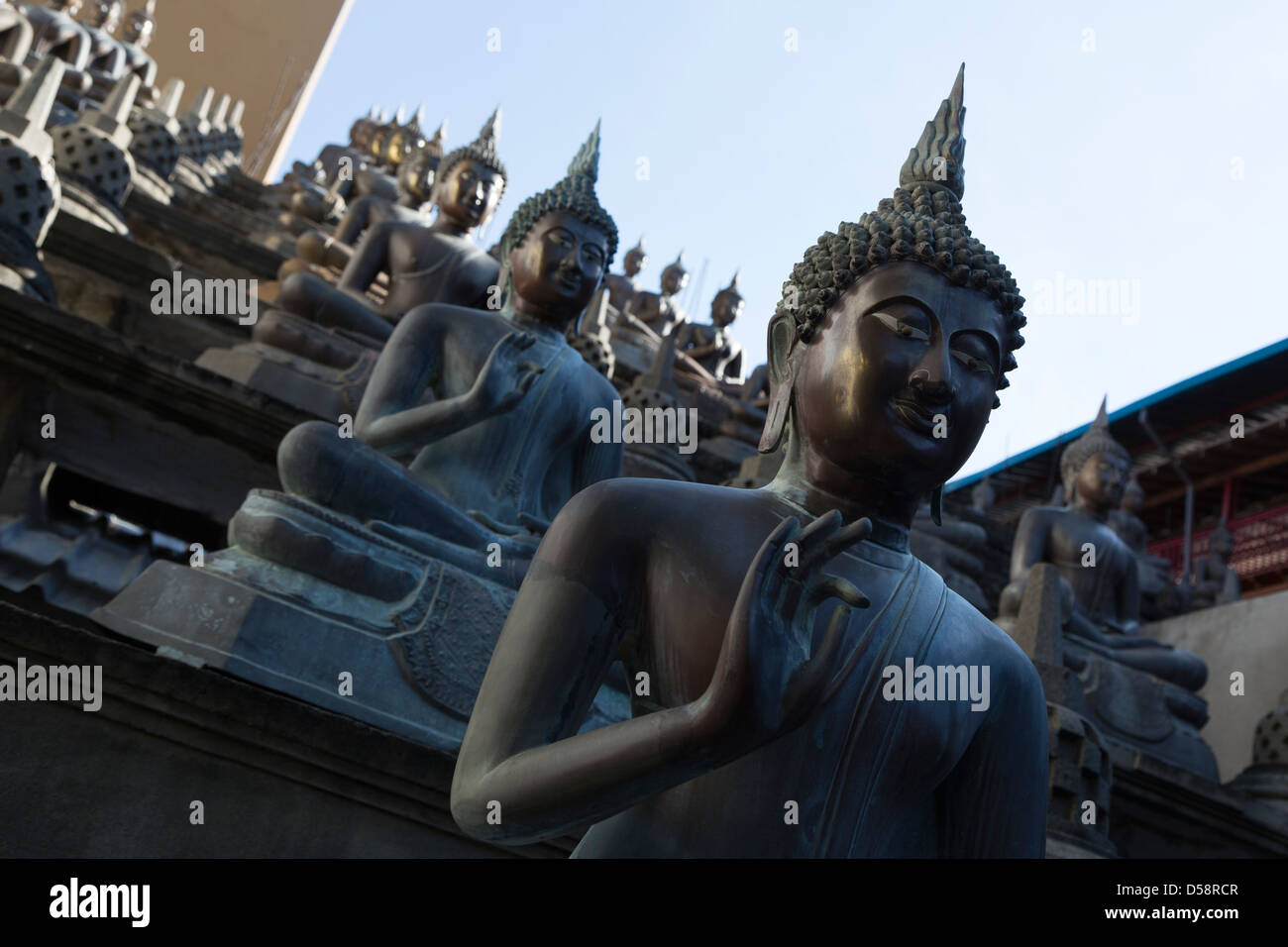 A repetition of Buddha statues in the  Gangaramaya Temple in Colombo, Sri Lanka - Stock Image