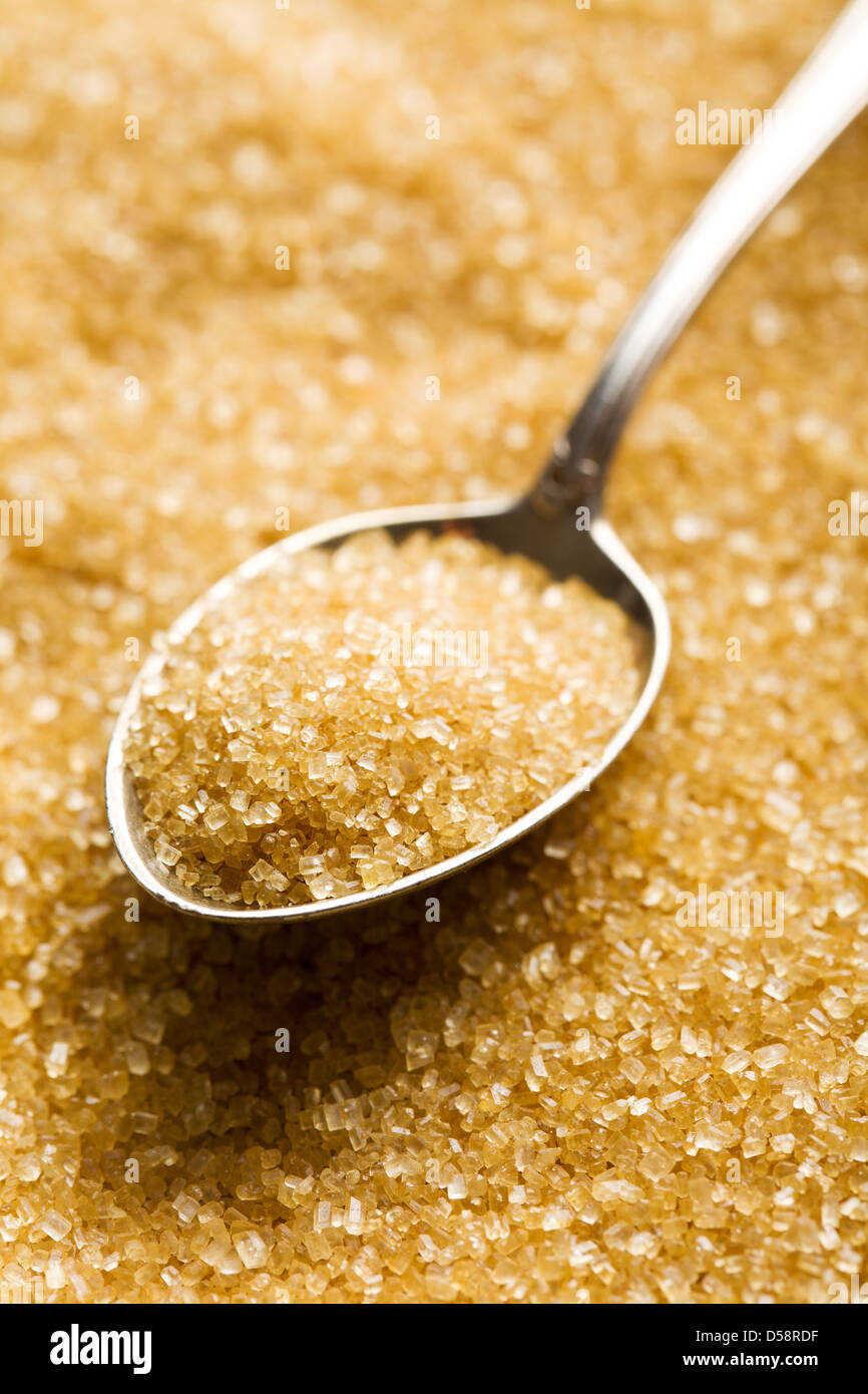 the brown sugar in silver spoon - Stock Image