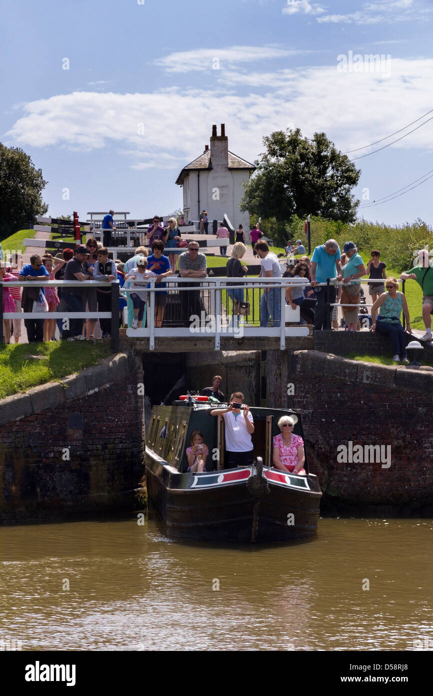 Barge emerging from lock on a busy day at Foxton Locks, Grand Union Canal, Market Harborough, Leicestershire, England, - Stock Image