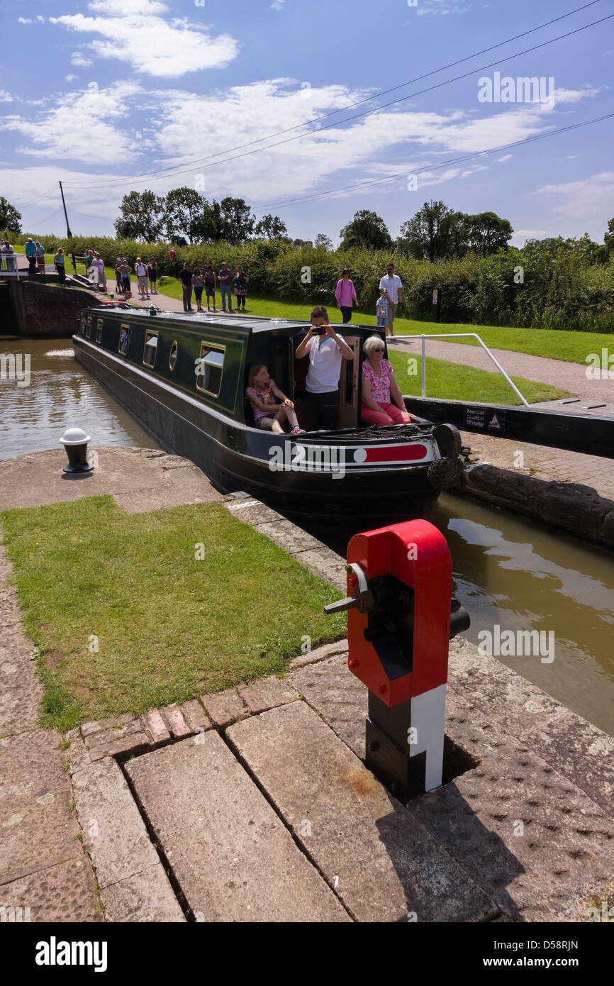 Barge entering lock on a busy day at Foxton Locks, Grand Union Canal, Market Harborough, Leicestershire, England, - Stock Image